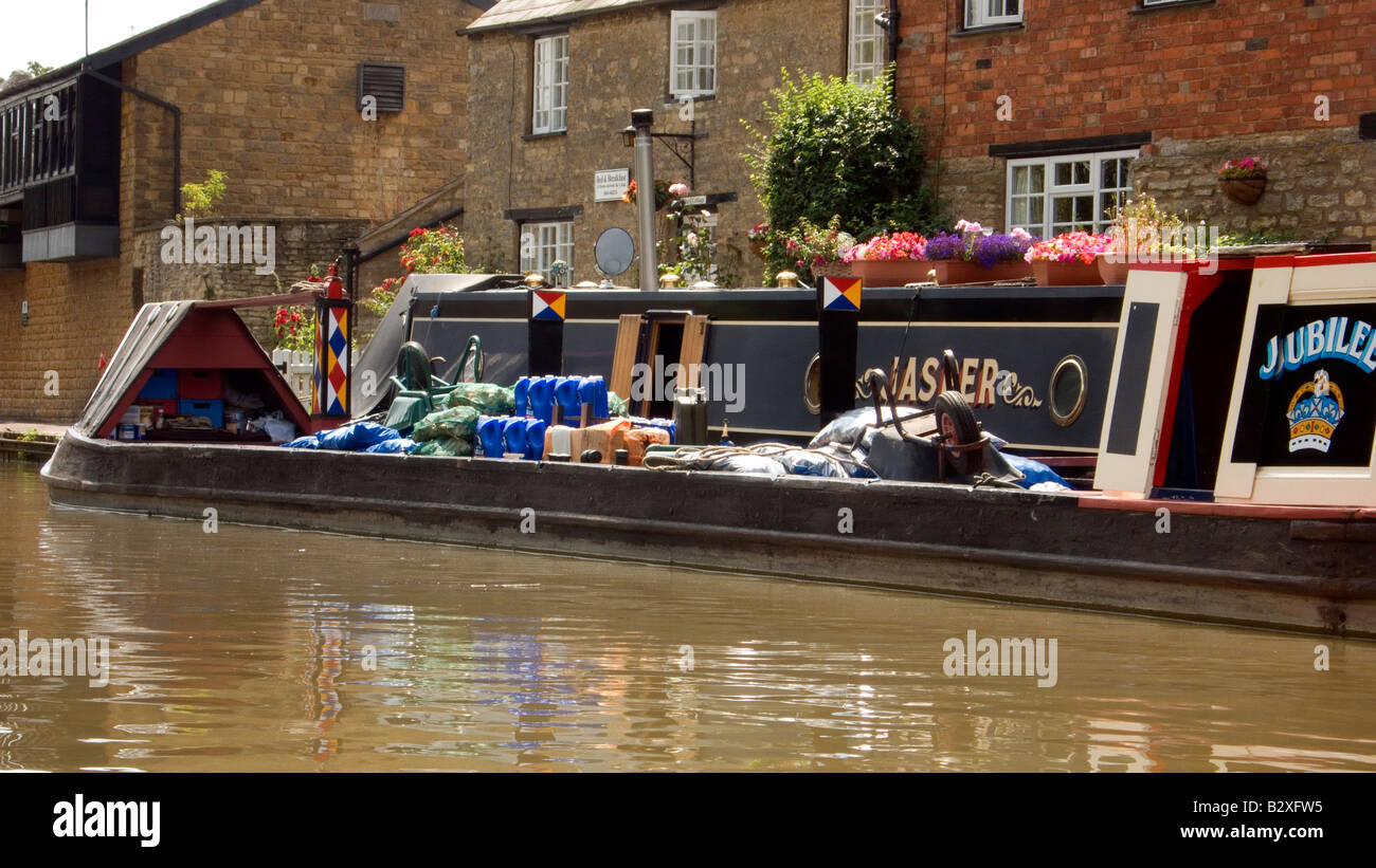 Historic traditional working boat Jubilee with cargo of coal at Stoke Bruerne on the Grand Union Canal Doug Blane Stock Photo