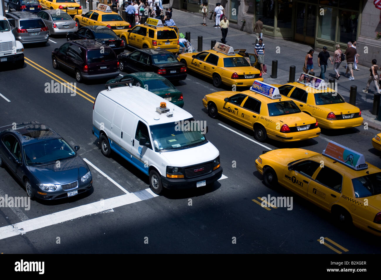 A Consolidated Edison truck navigates through midtown traffic in Manhattan, NY. - Stock Image