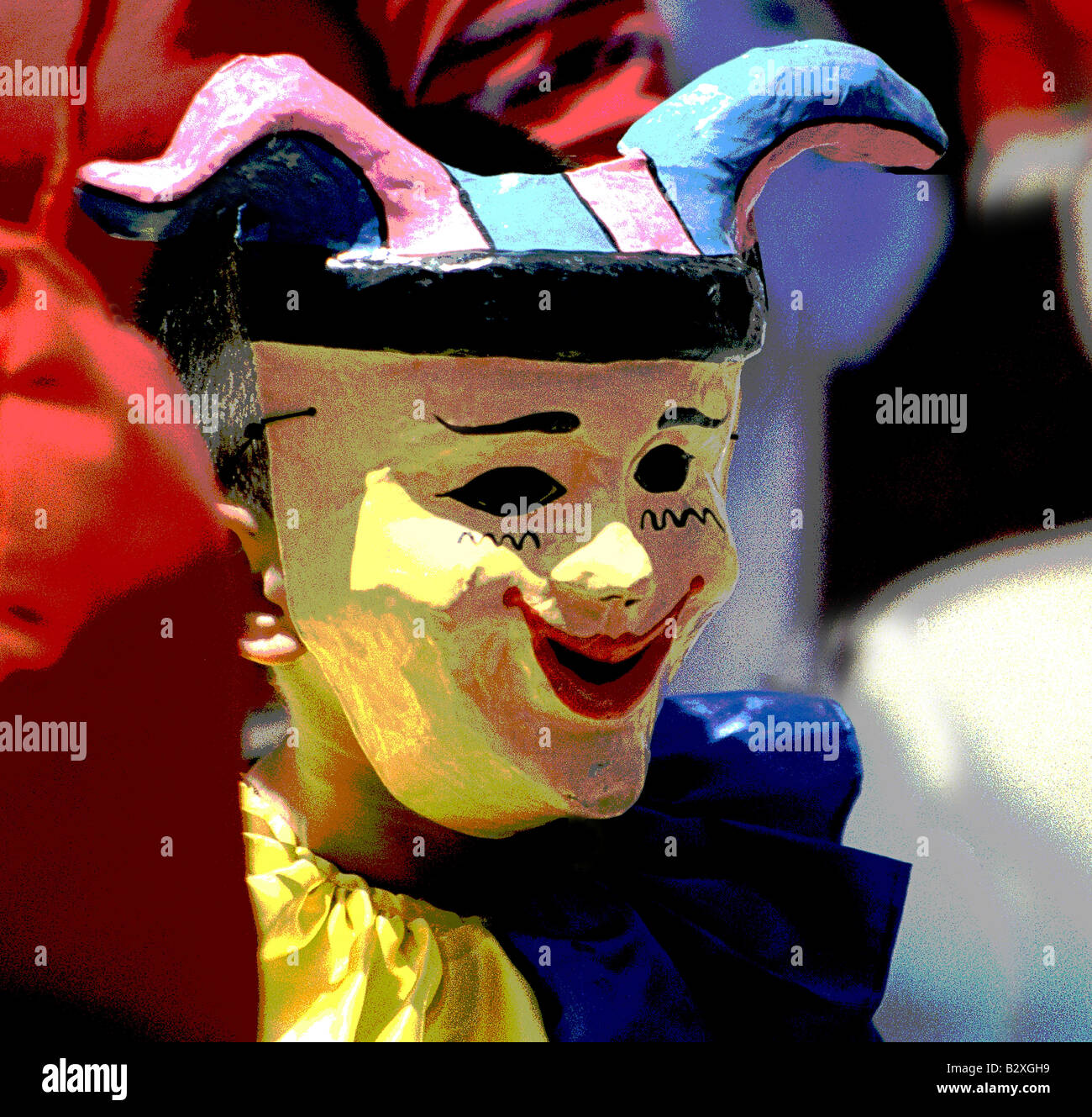 Photo digital illustration of parade goer in multicolored costume and paper maché mask at fiesta festival parade - Stock Image