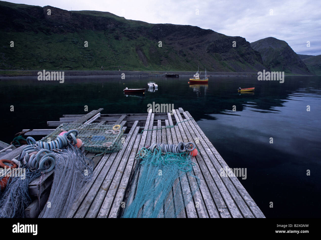 Norway midnight sun in little port south of Honningsvag - Stock Image
