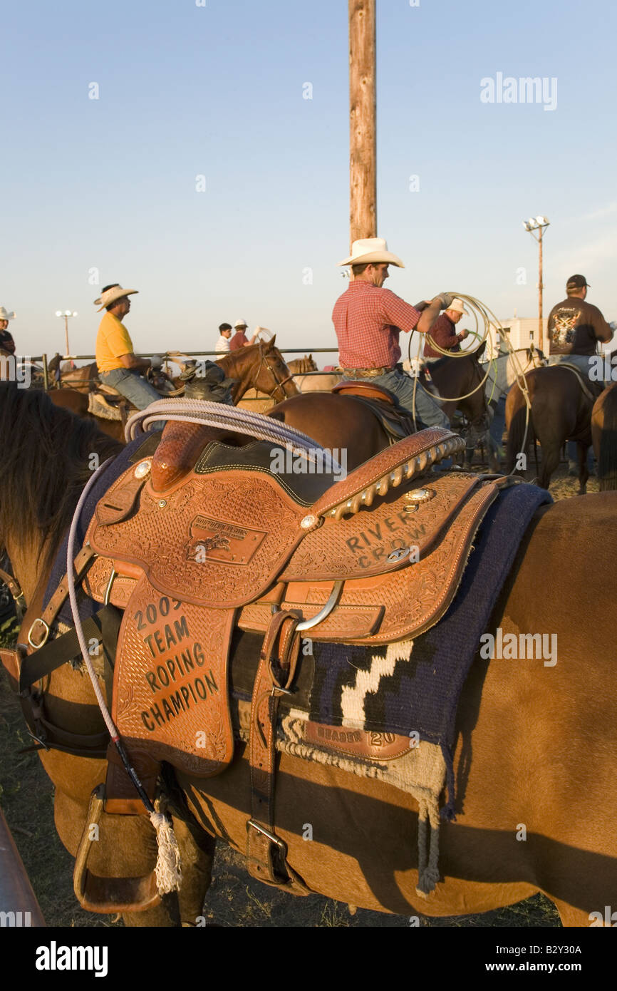 Close-up of saddle and cowboy at PRCA Rodeo at Lower Brule, Lyman County, Lower Brule Sioux Tribal Reservation, - Stock Image