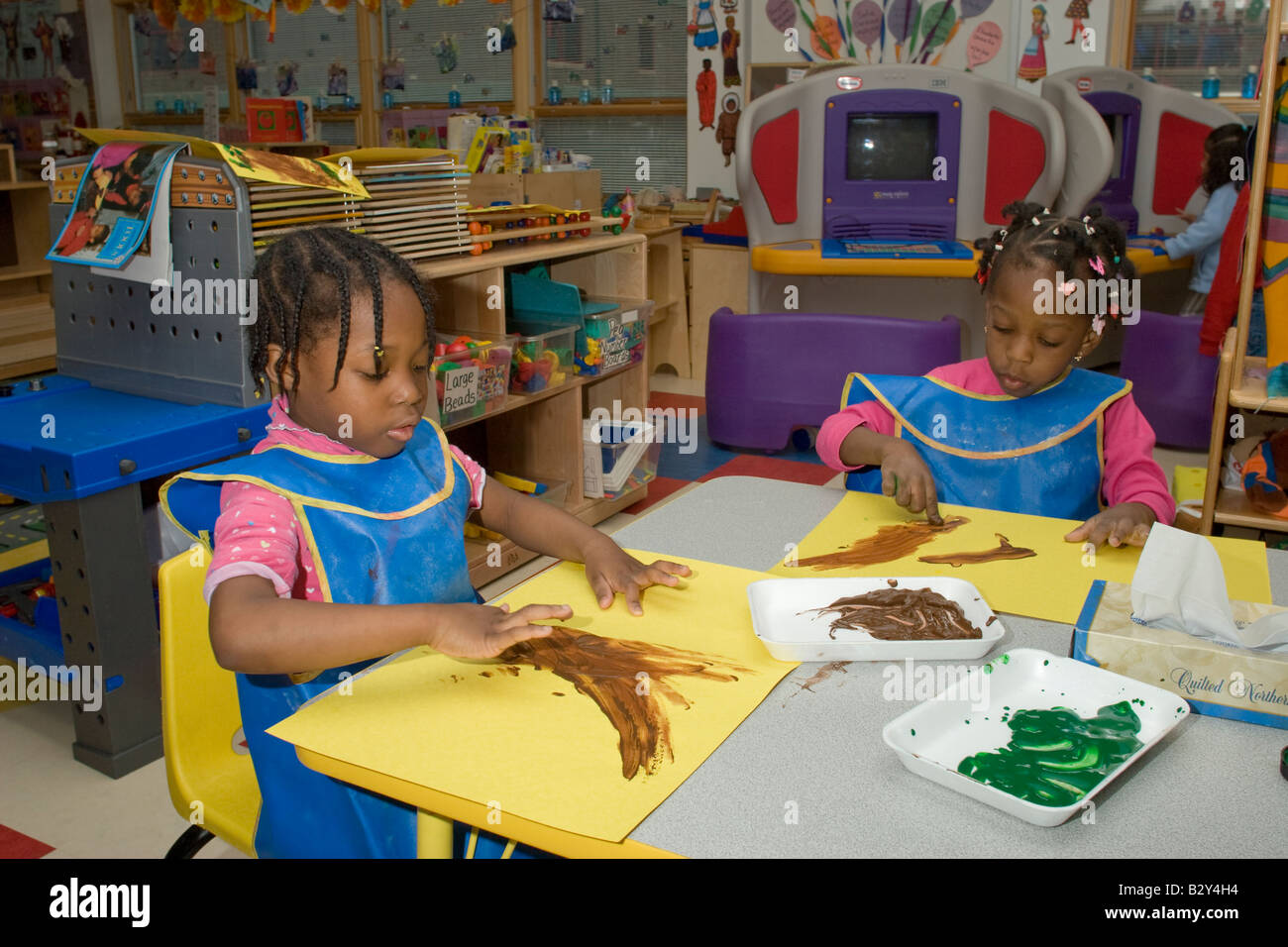 Two 4 Year Old African American Girls Finger Painting In Preschool Class