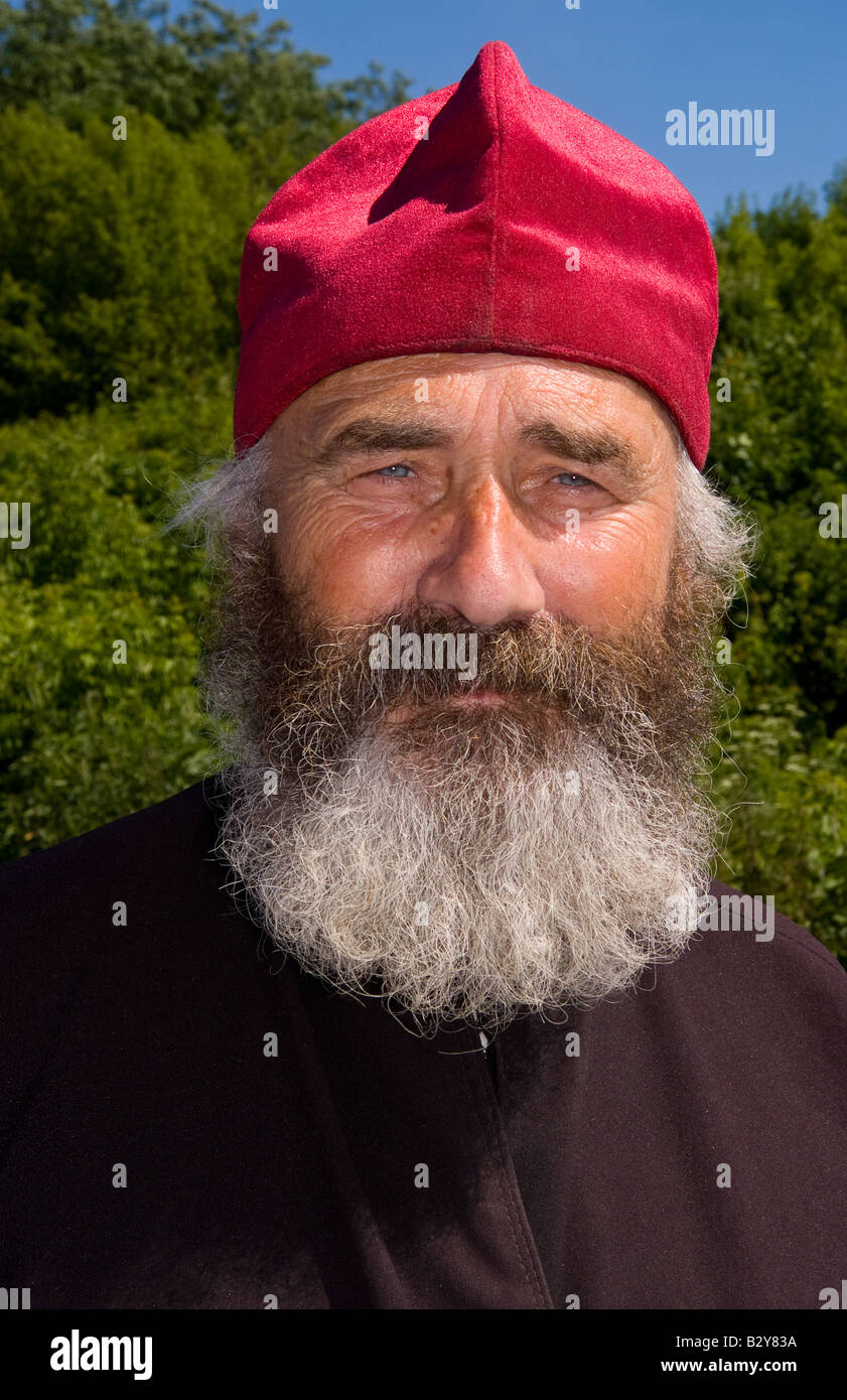 Portrait of Russian Orthodox priest in red hat in country of Lviv Ukraine - Stock Image