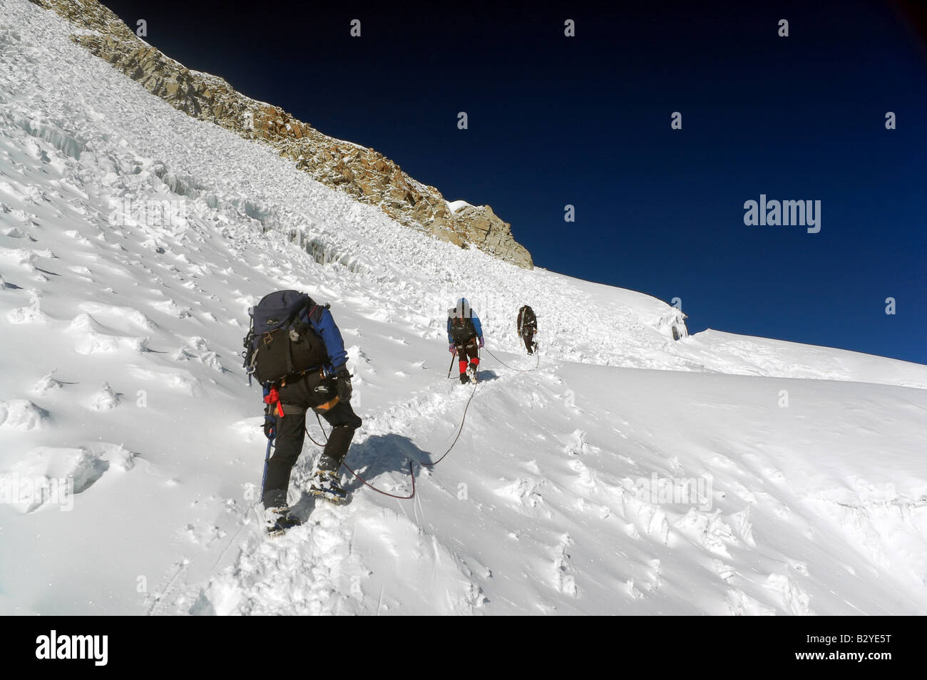 Mountaineers climbing Huayna Potosi, a 6000m peak and part of Bolivia's Cordillera Real. - Stock Image