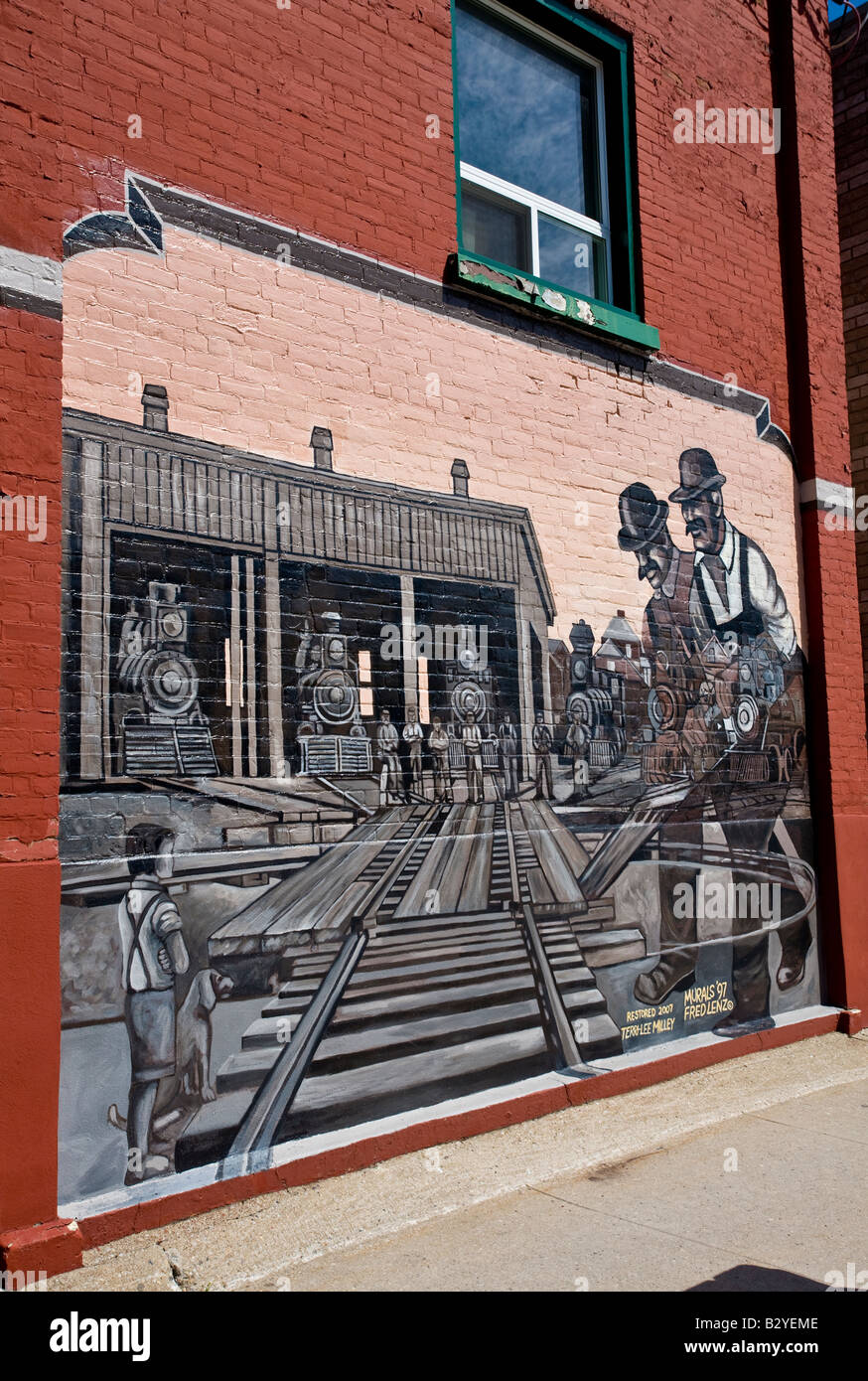 Mural by fred lenz depicting work on the train system at midland bay ontario canada