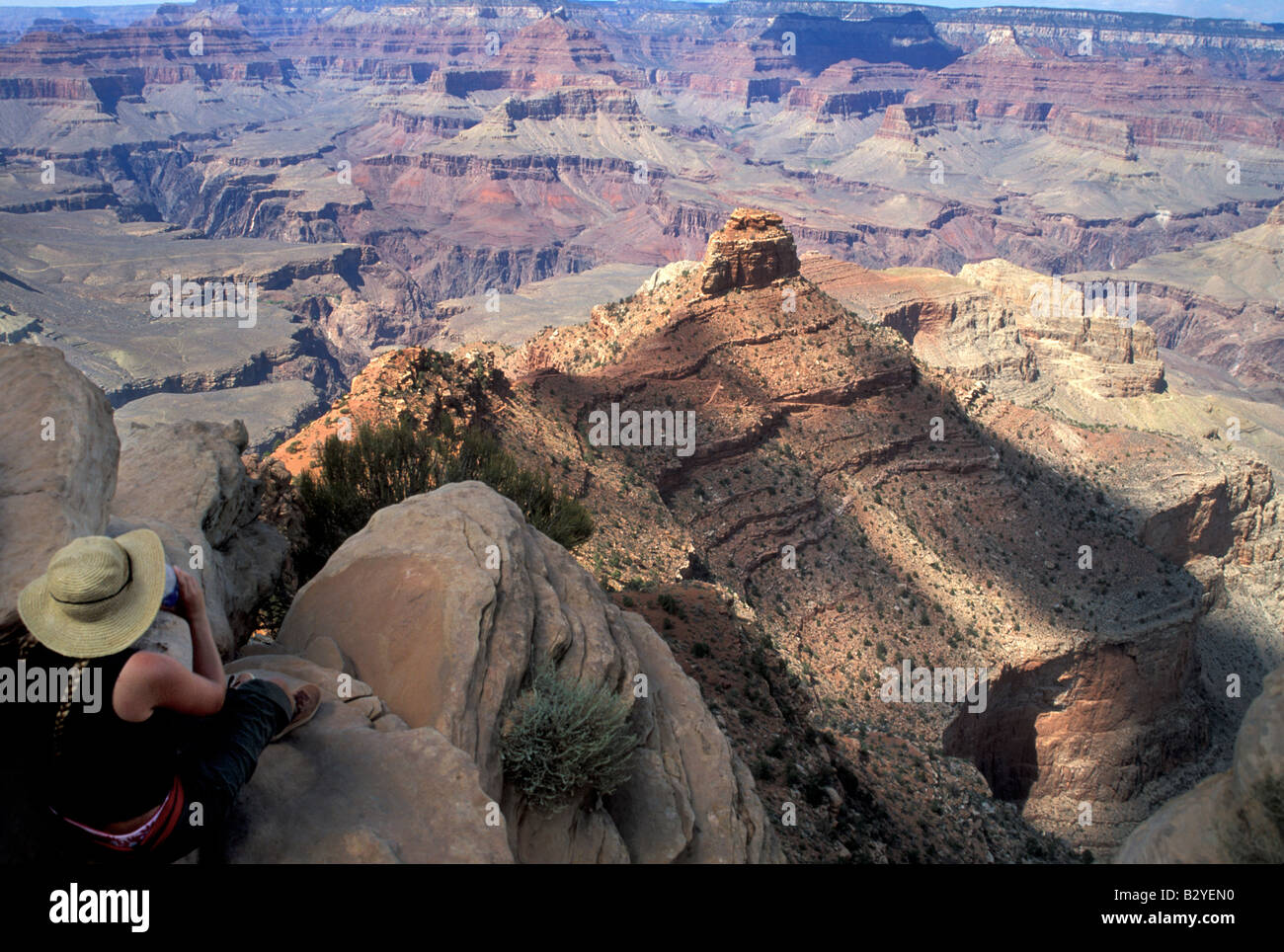 A hiker enjoys the view from Ooh Ahh point on the South Kaibab Trail in the Grand Canyon - Stock Image