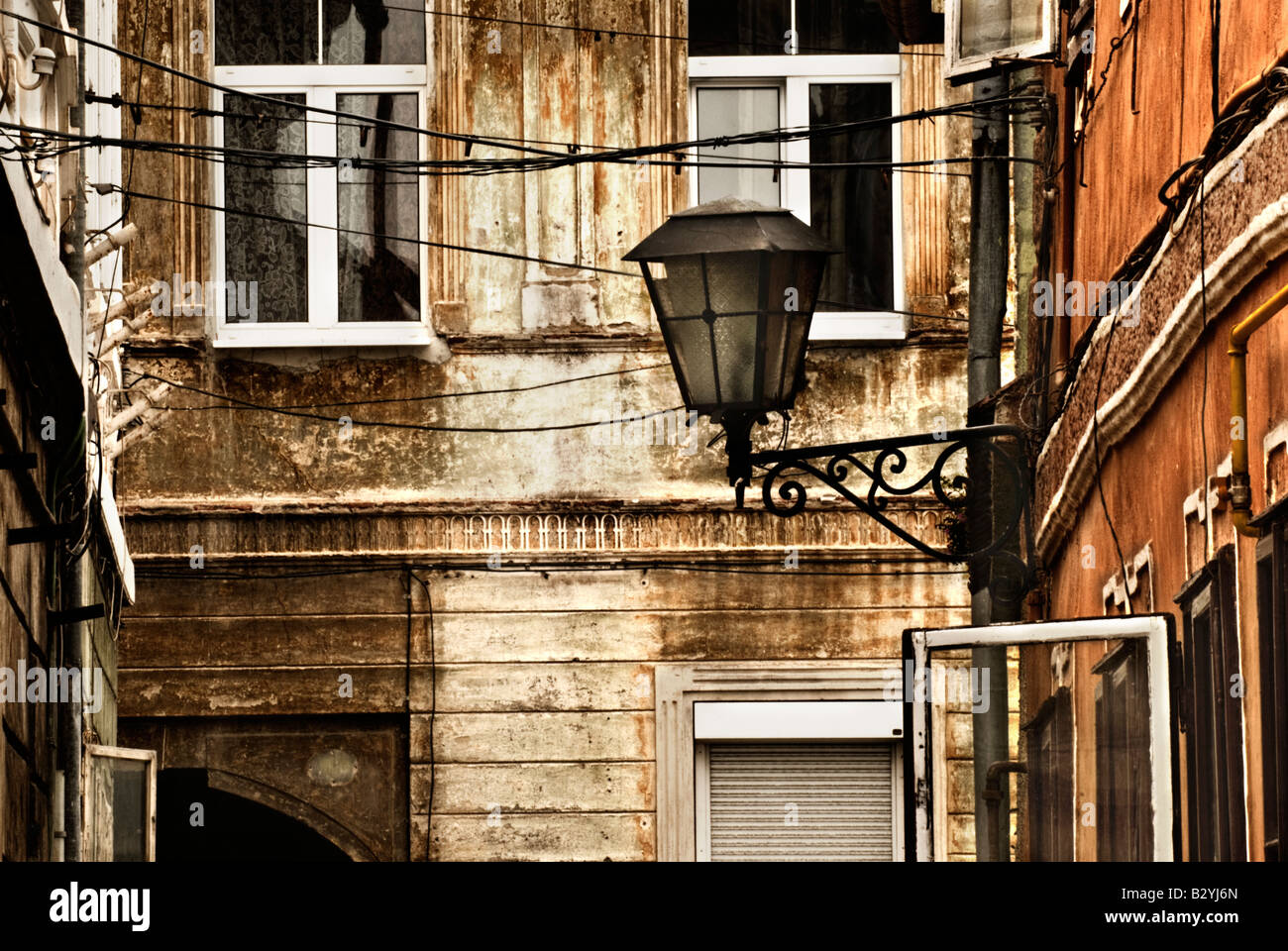 Deail of streetlight and buildings in Brasov, Romania - Stock Image