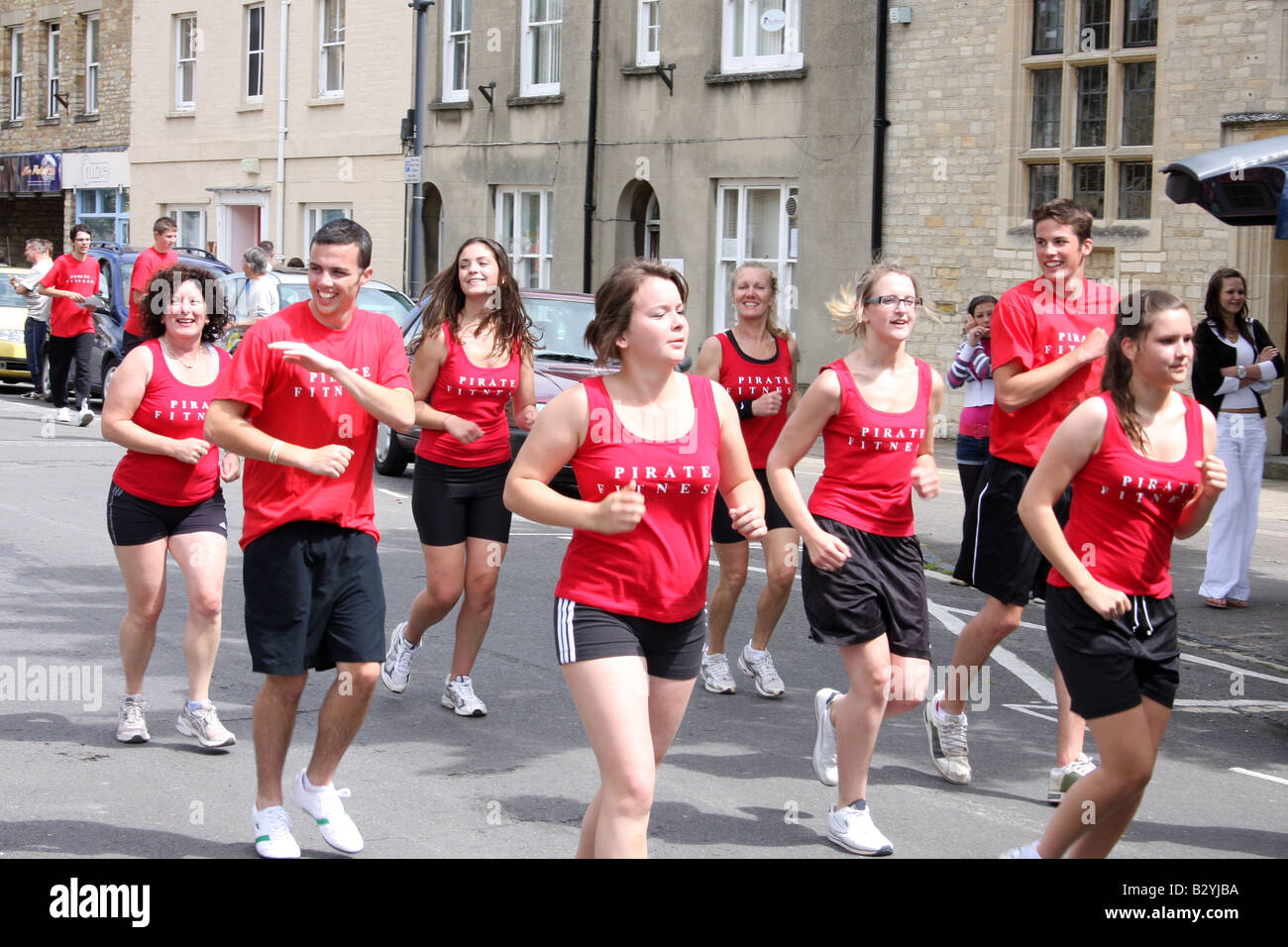A group of people exercising at Witney Carnival Oxfordshire. - Stock Image