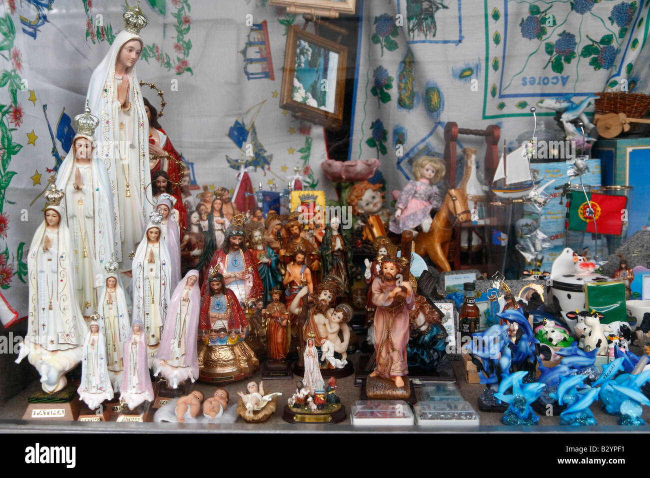 Small shop in the Azores islands selling figurines of Our Lady of Fatima (left), and other kinds of memorabilia - Stock Image