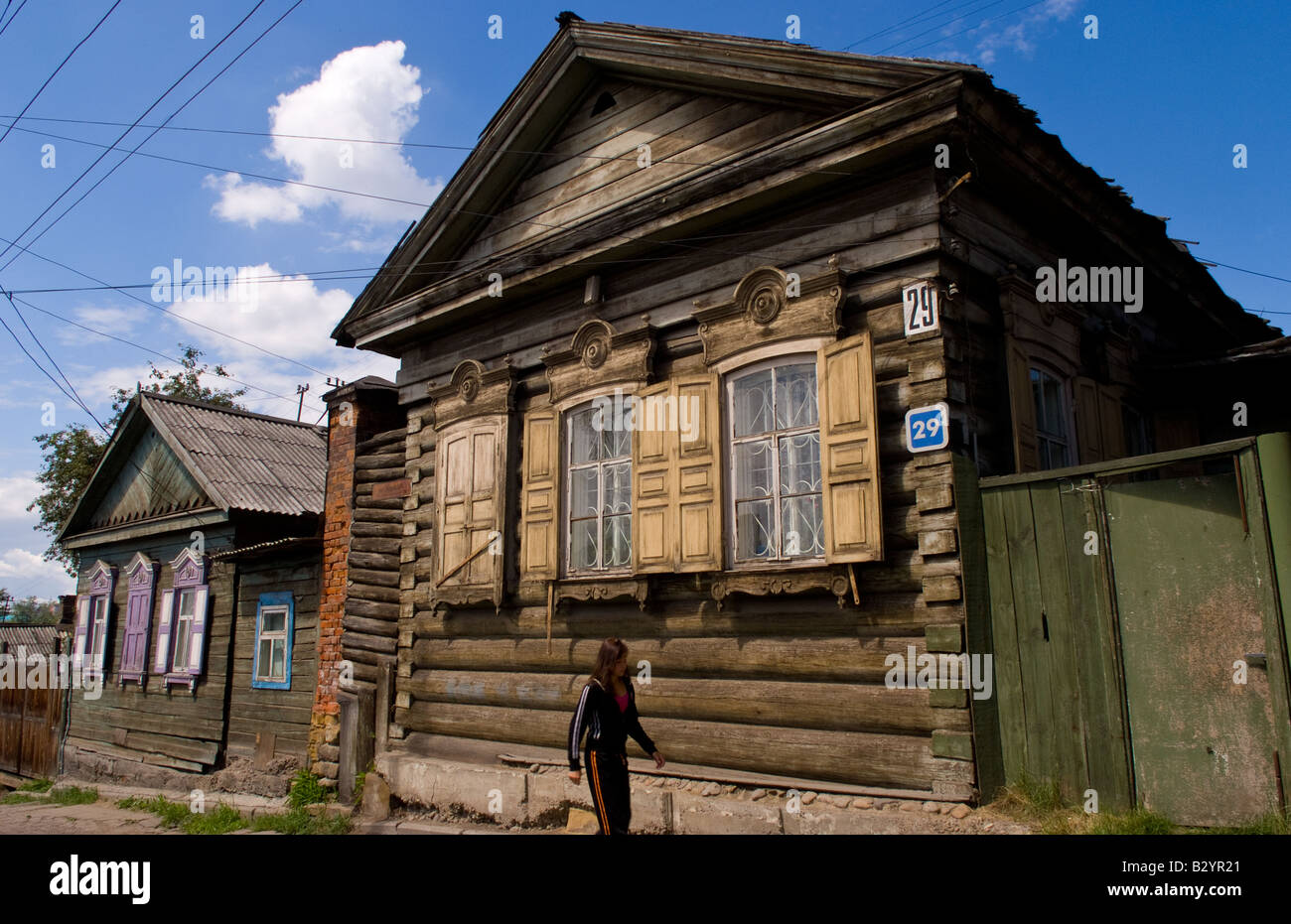Beautiful old wooden houses with shutters irather worn for Beautiful classic houses