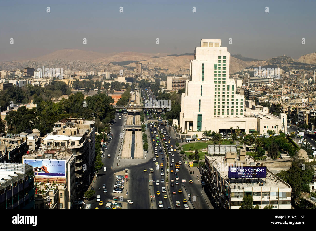 Syria. Morning traffic on wide Beirut Avenue in the modern part of Damascus Stock Photo