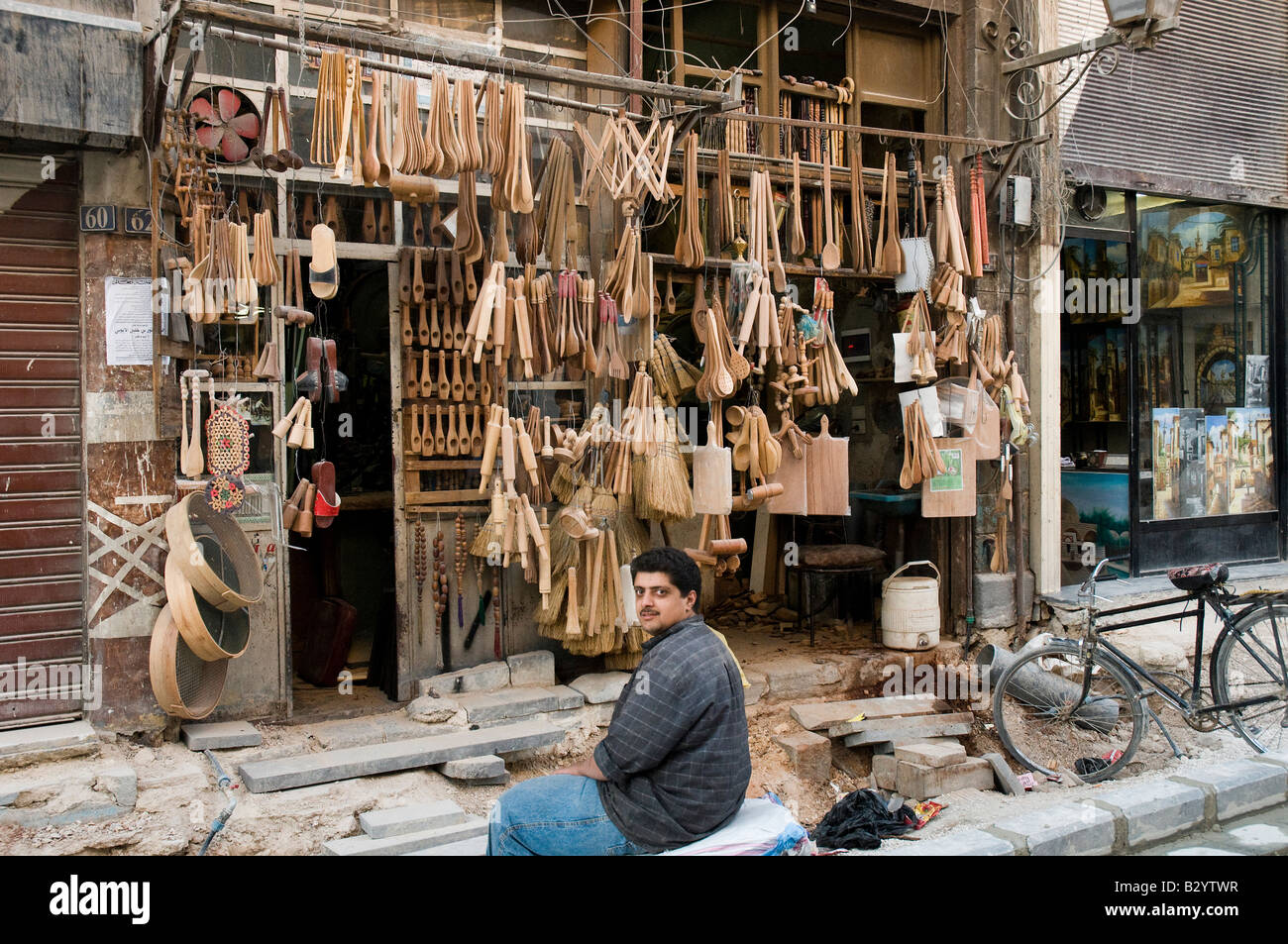 Syria. Shop selling kitchenware and items in wood in center of Damascus.  Street being repaired and modernized Stock Photo