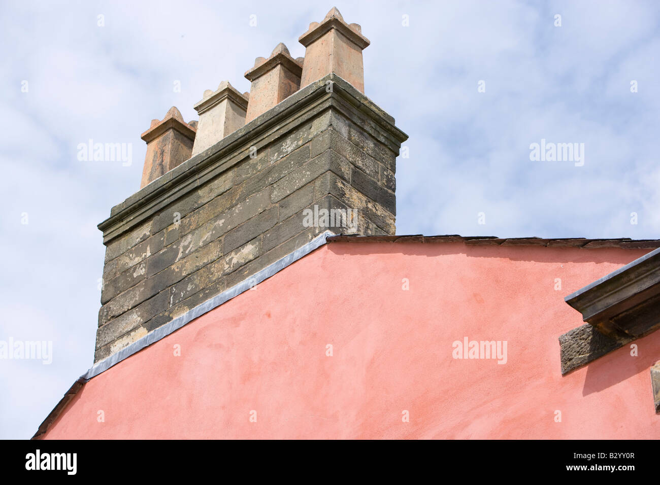 4 chimney pots on the gable end of a Georgian house - Stock Image