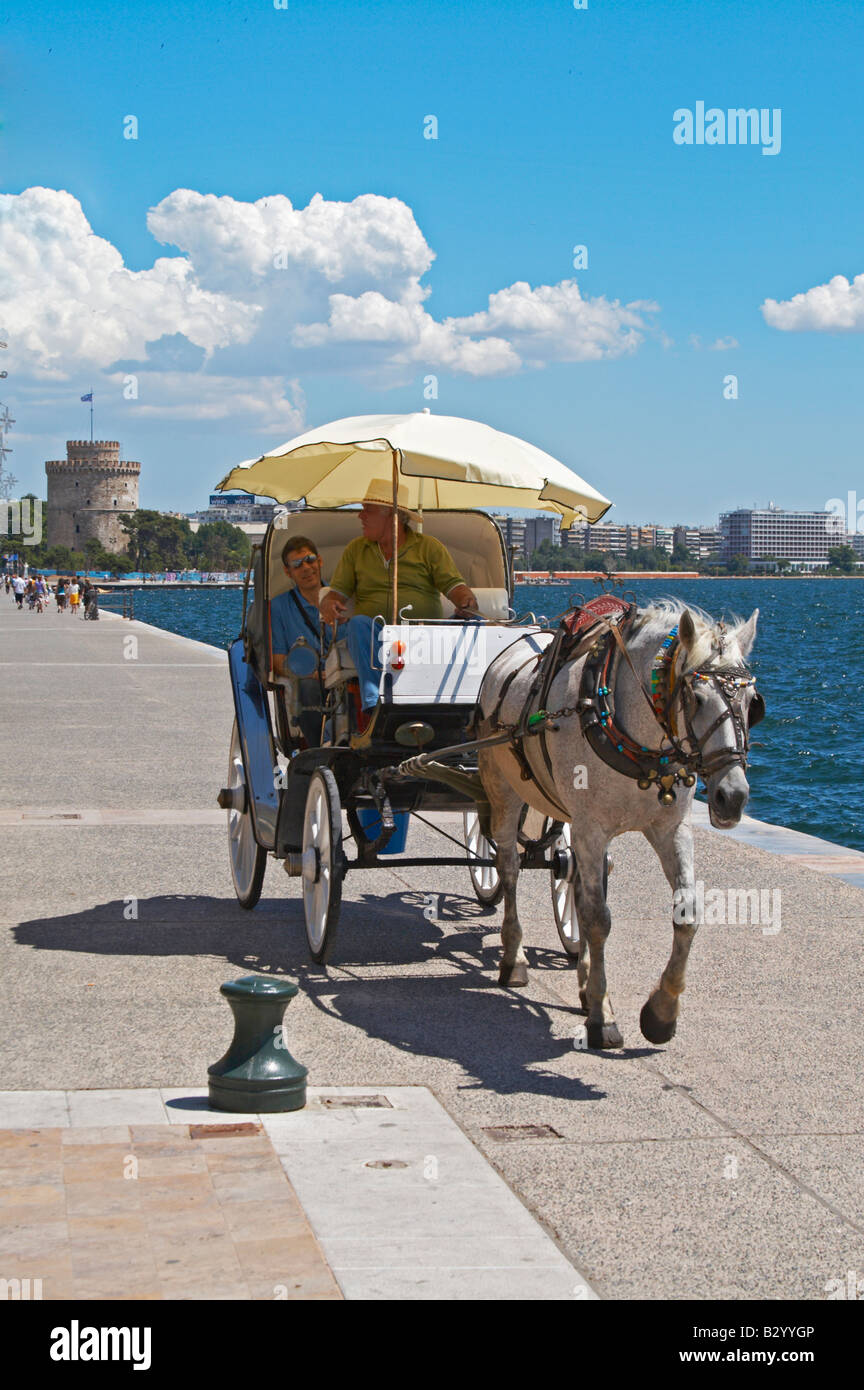 Horse drawn carriage on the waterfront. Thessaloniki, Macedonia, Greece - Stock Image