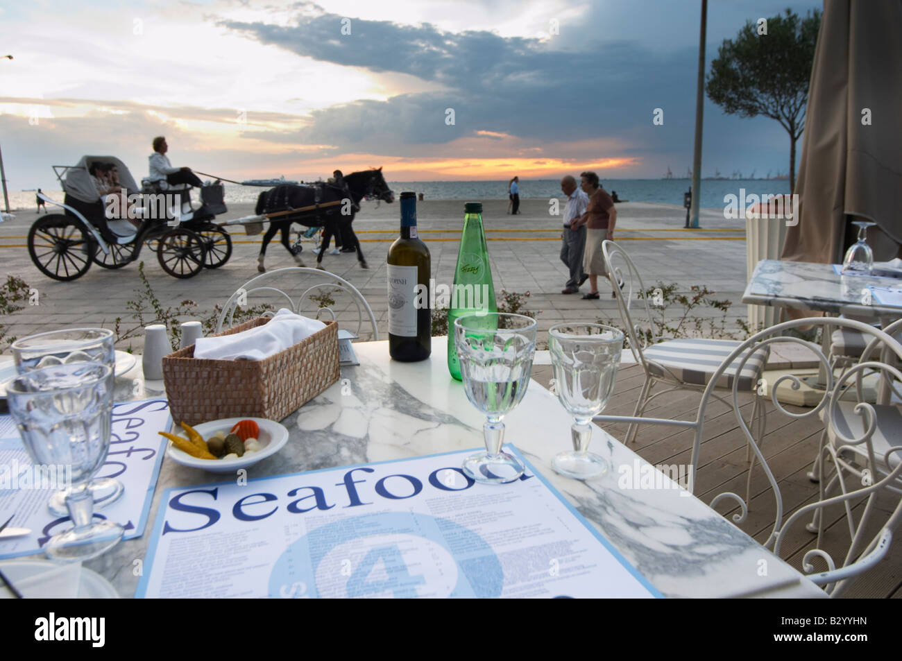 Dinner at a waterfront restaurant. Horse drawn carriage. Seafood restaurant at Macedonia Palace Hotel. Thessaloniki, - Stock Image