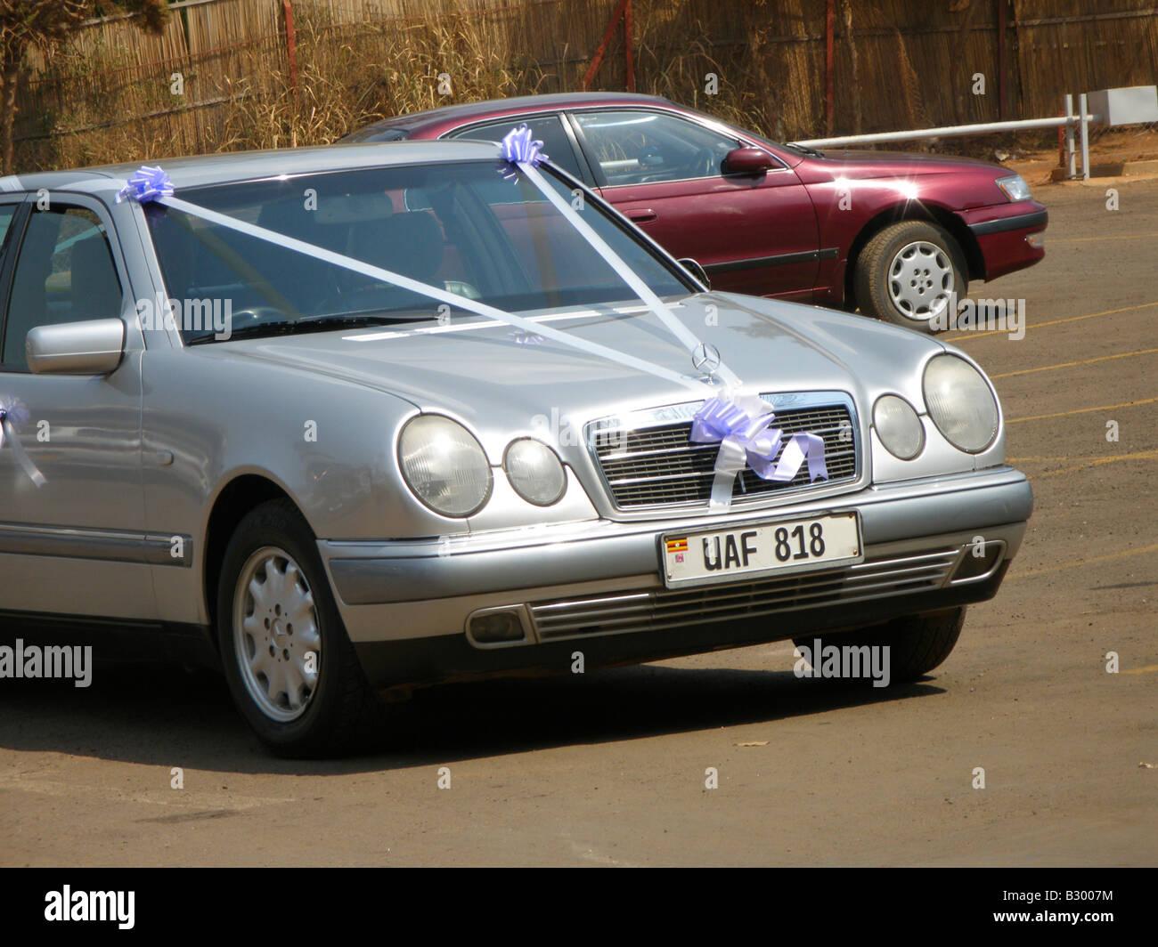 Typically decorated rented wedding entourage car, Uganda - Stock Image