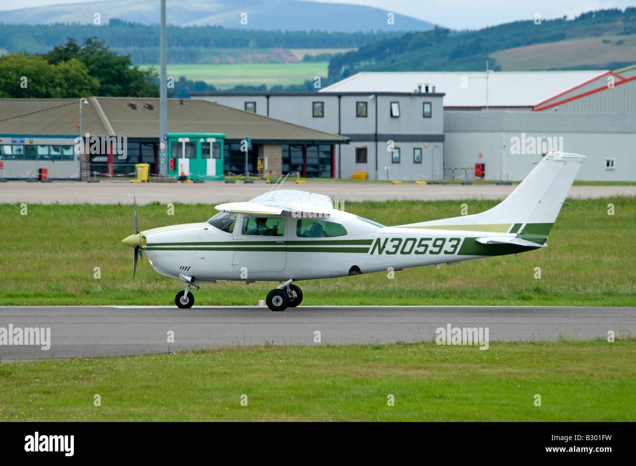 Cessna 210L Light Private Aeroplane Dalcross Airfield Inverness Scotland UK - Stock Image