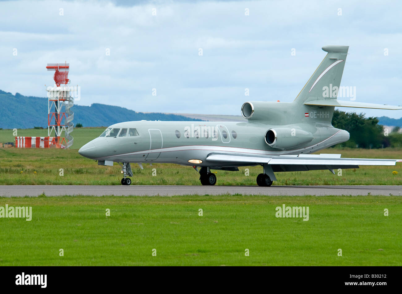 Dassault Falcon 50EX Three Engined Jet Aircraft on the runway arriving at Inverness Airport. - Stock Image