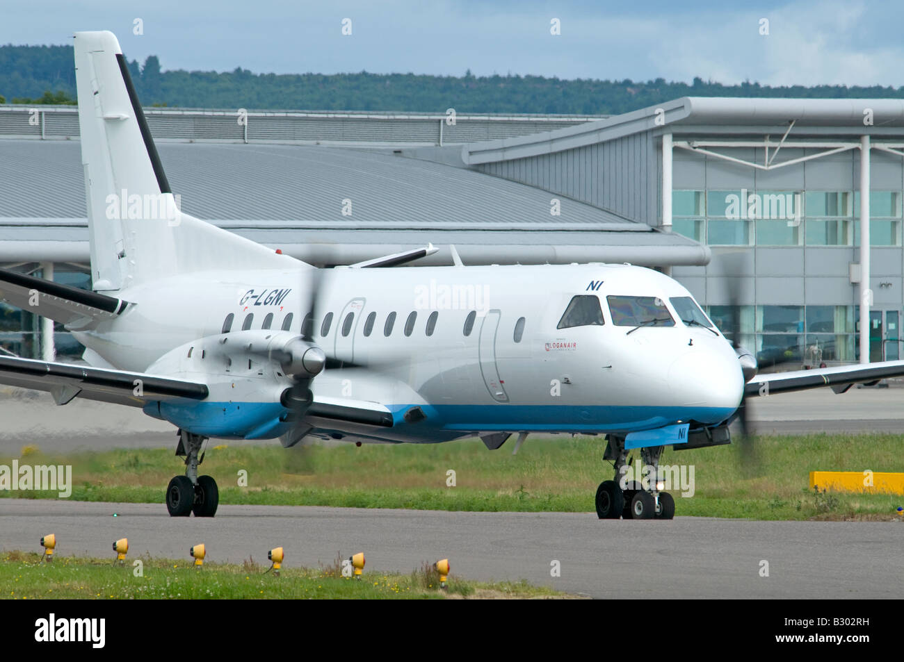Saab SF 340B Turbo Prop Passenger Aircraft owned by Flybe operated by Loganair at Inverness Airport Stock Photo