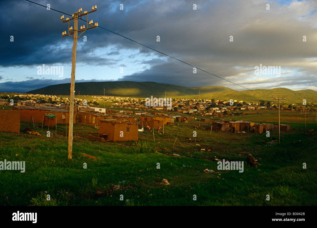 Settlement of huts with electricity supply cables. KwaZulu-Natal Midlands, South Africa. Stock Photo
