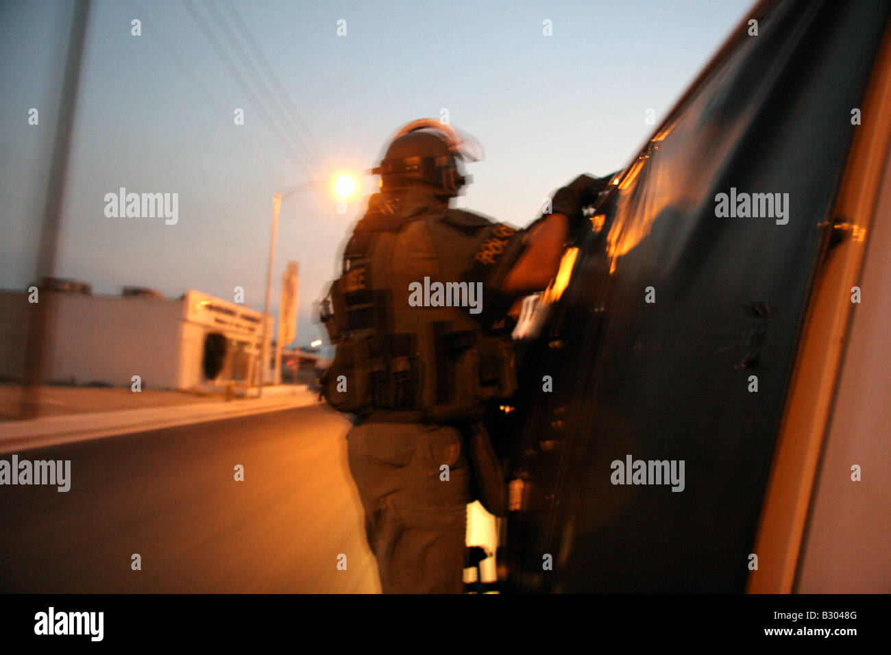 Las Vegas SWAT police officer holding onto the side of an attack van Stock Photo