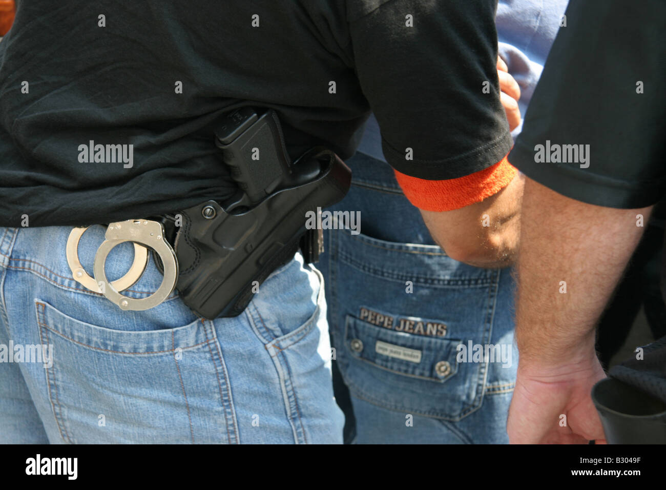 Plain Clothes police detectives in New York City search a suspect - Stock Image