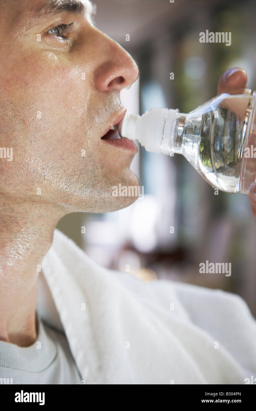 Man Drinking Water after Exercising Stock Photo