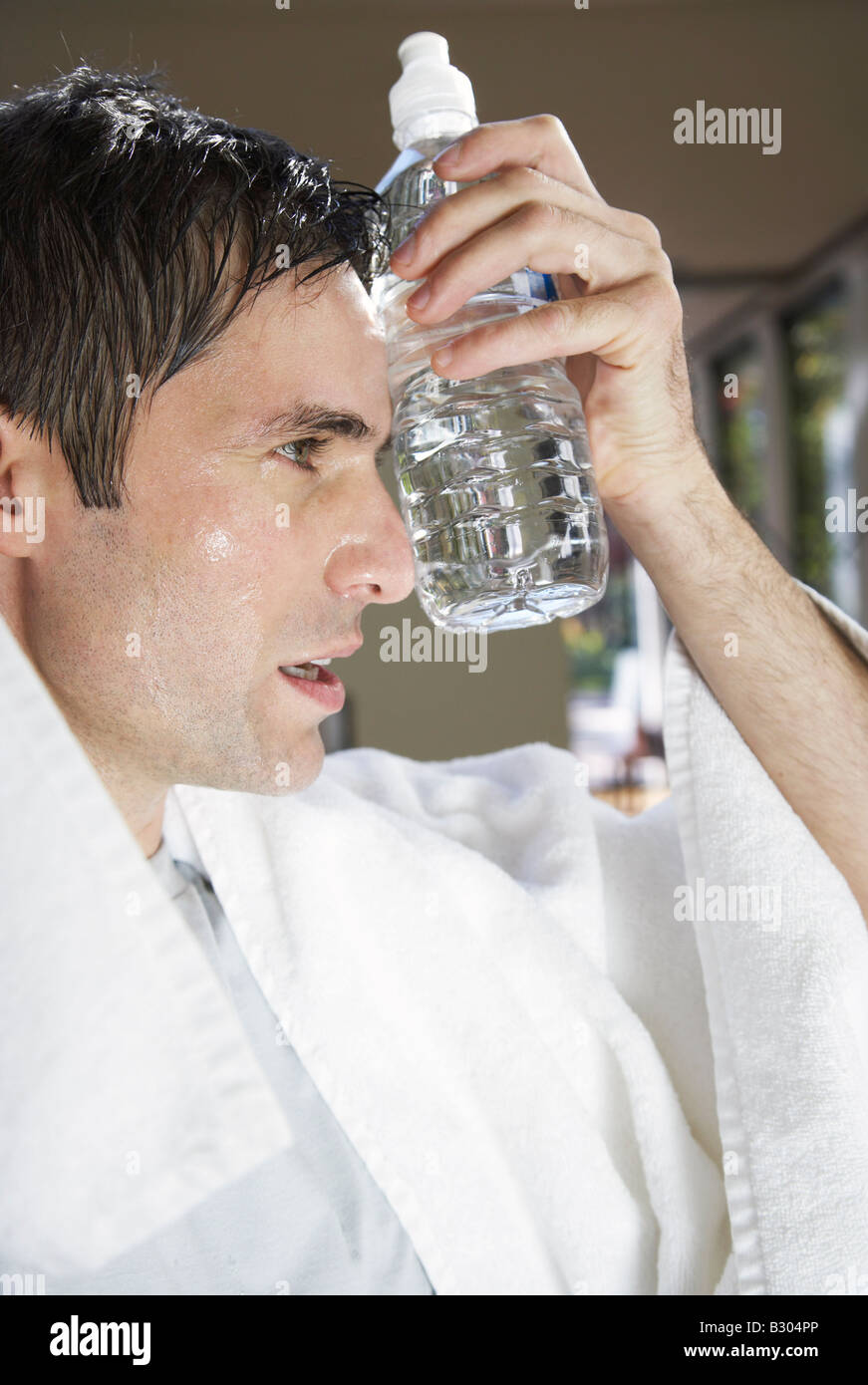 Man with Water Bottle after Exercising Stock Photo