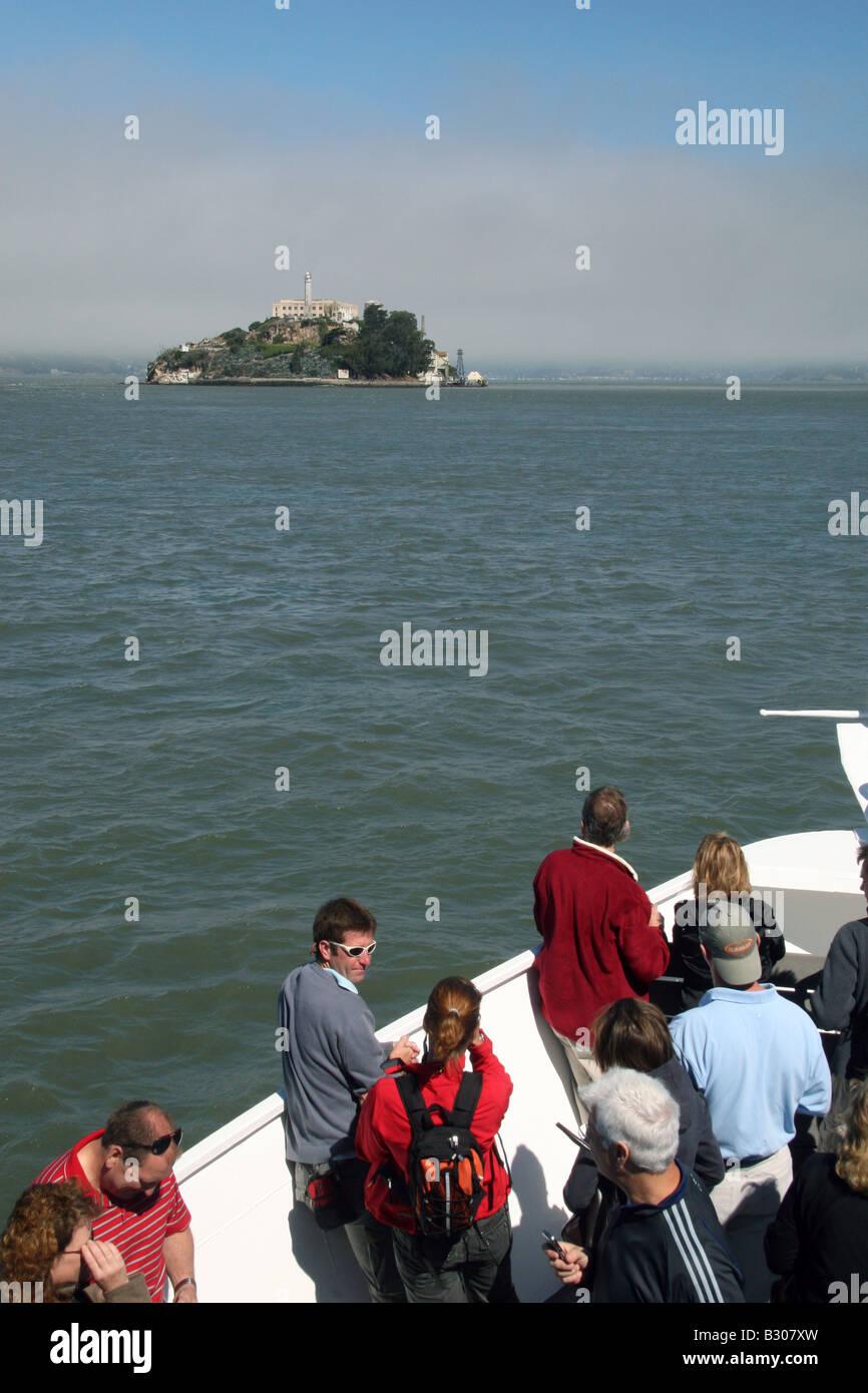 Passengers on the ferry ride to Alcatraz Island, San Francisco Bay, California. - Stock Image