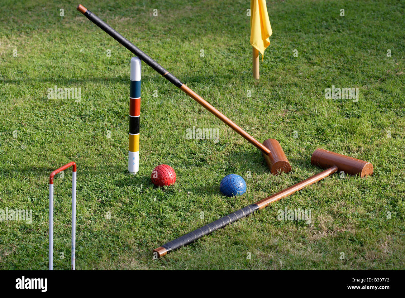Croquet mallets and balls on a lawn - Stock Image