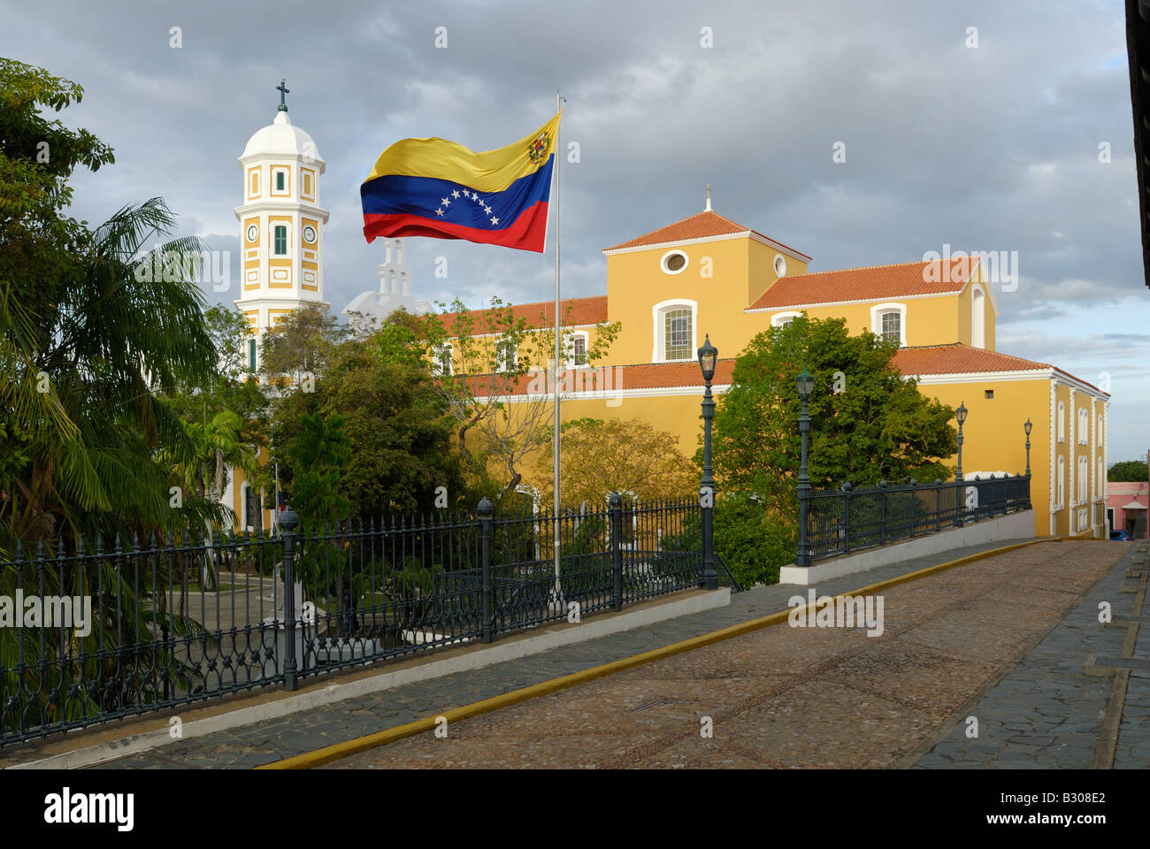 Cathedral and flag historic city centre Ciudad Bolivar, Venezuela, South America - Stock Image