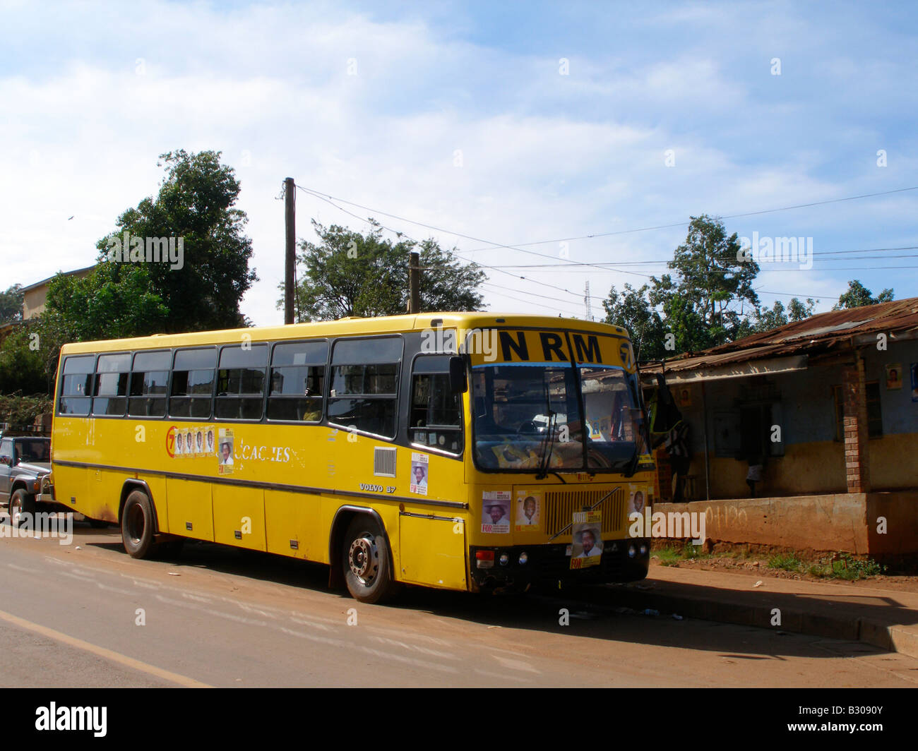 The yellow NRM bus with presidential campaign posters in Kampala, Uganda Stock Photo