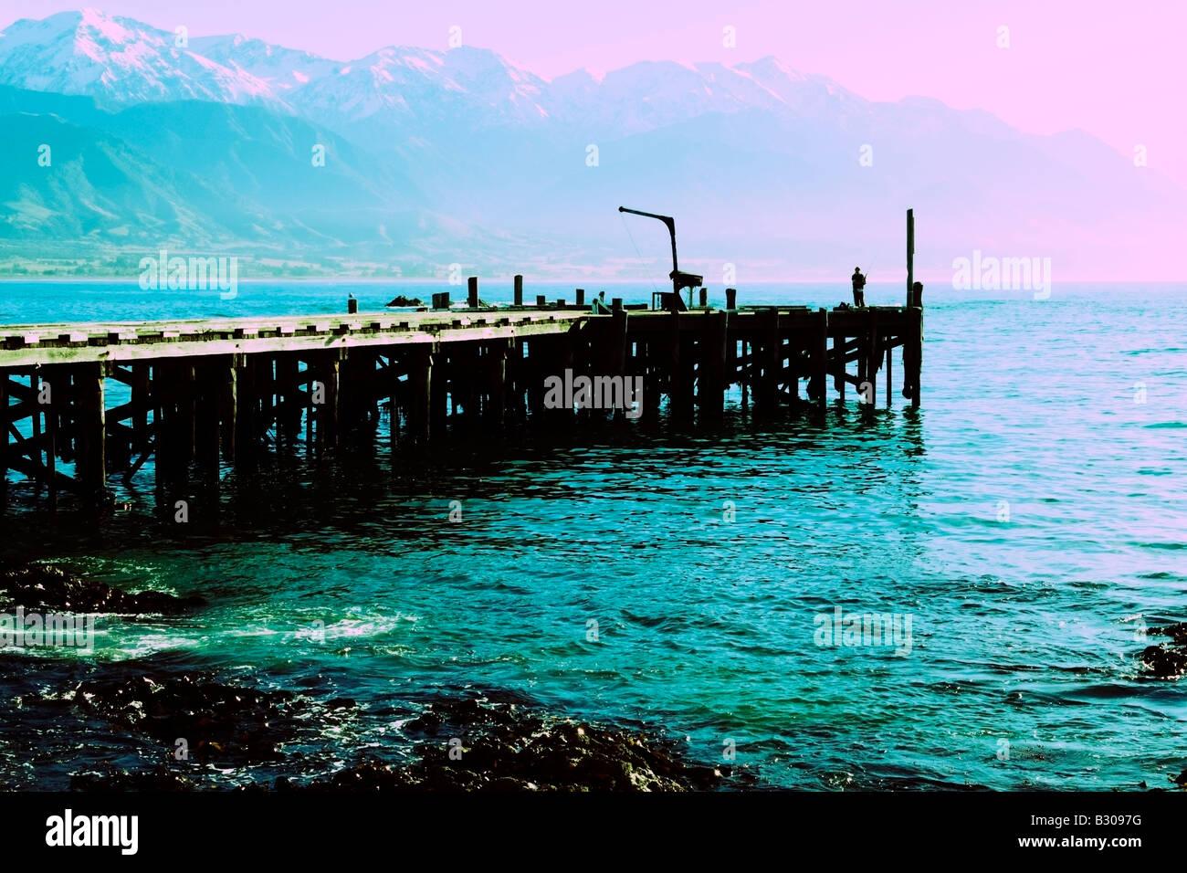 Solitary fisherman, Kaikoura jetty, South Island, New Zealand - Stock Image