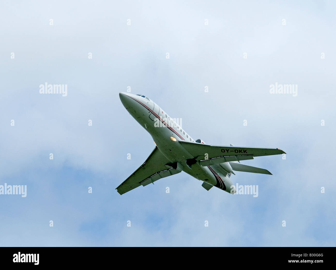 Dassault Falcon 900EX owned by the Danish Lego company leaving Inverness Airfield - Stock Image
