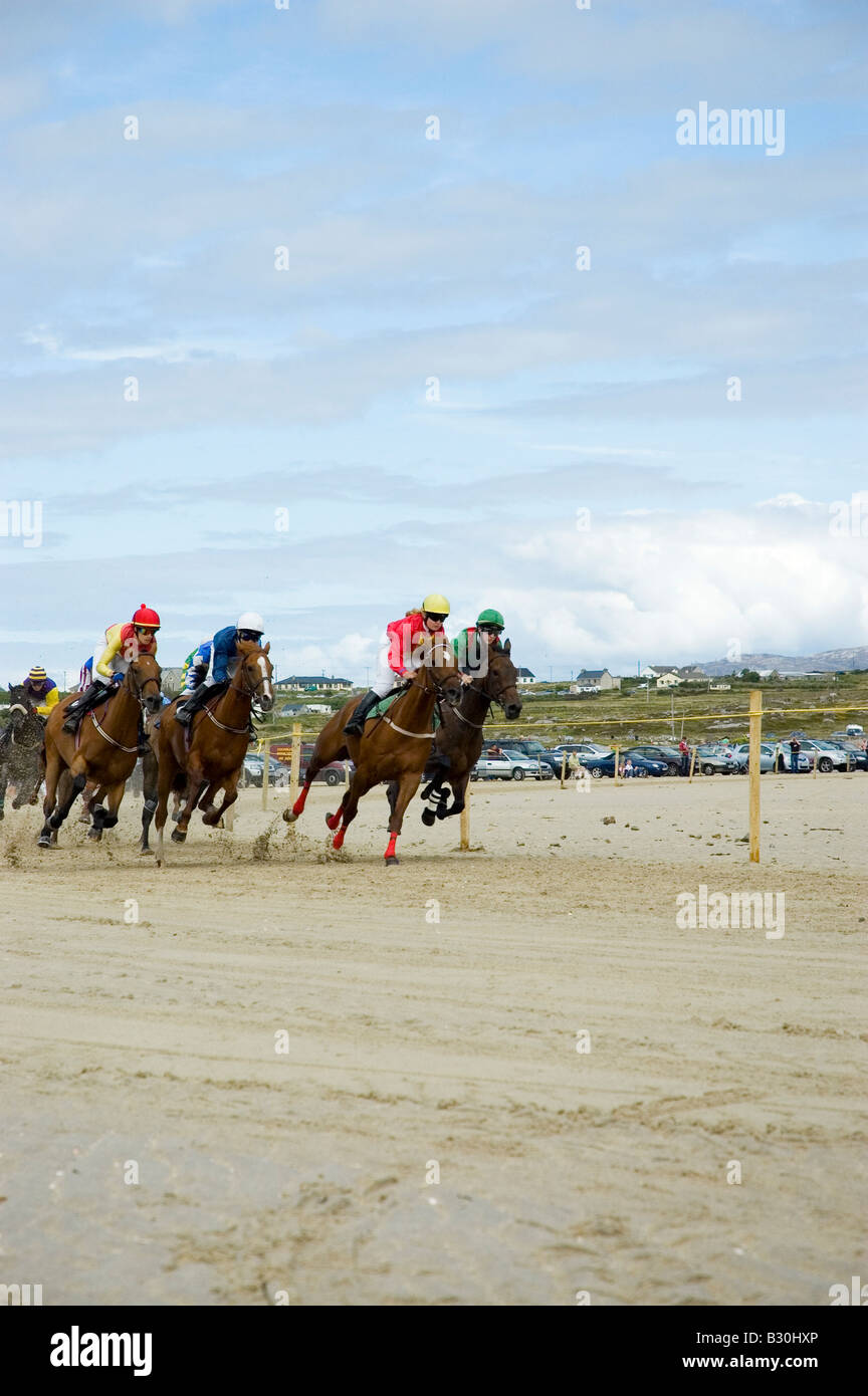 Pony racing on the beach, Omey Races, near Clifden, Connemara, County Galway, Ireland - Stock Image