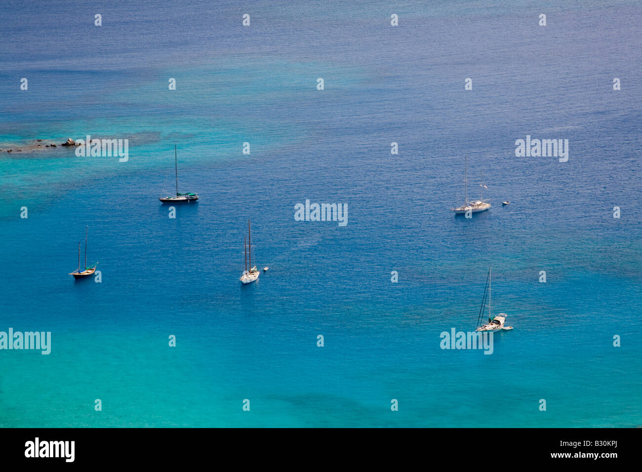 Sailboats anchored in Coral Bay on the caribbean island of St John in the US Virgin Islands - Stock Image