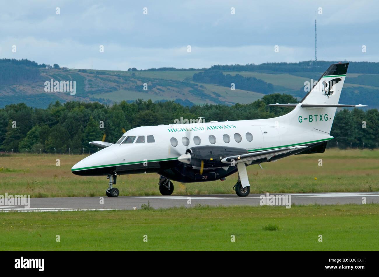 BAe Jetstream 3102 arriving at Inverness Airport Highland Region Scotland - Stock Image