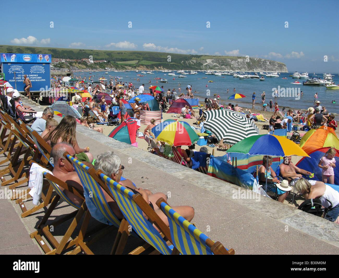 Crowded beach at Swanage, Isle of Purbeck, Dorset, England, Great Britain, United Kingdom, UK, Europe - Stock Image