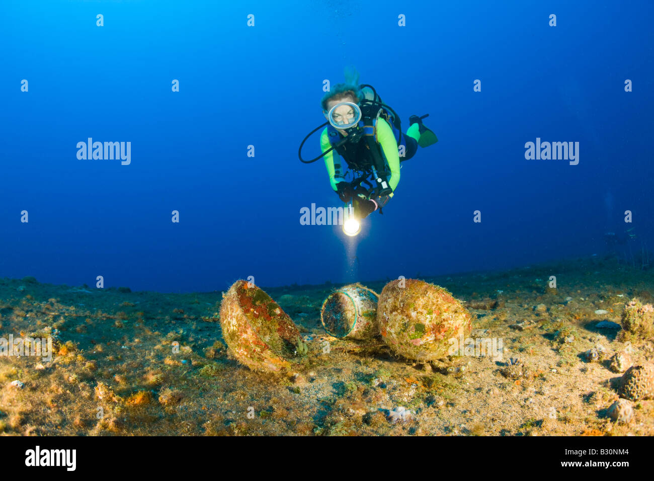 Diver discover Tableware at Destroyer USS Anderson Marshall Islands Bikini Atoll Micronesia Pacific Ocean - Stock Image