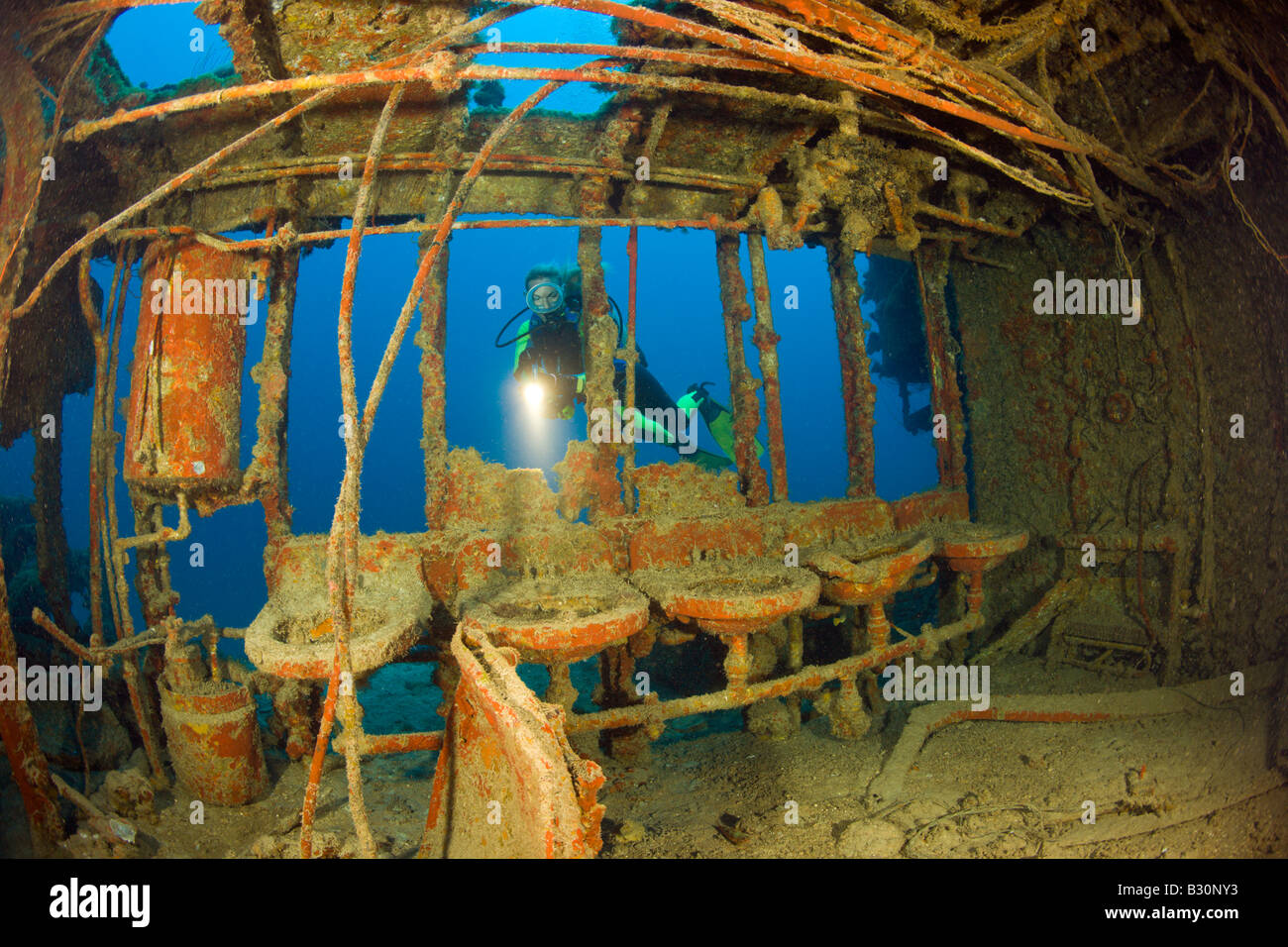 Diver near Lavatory with Sinks at Destroyer USS Lamson Marshall Islands Bikini Atoll Micronesia Pacific Ocean - Stock Image