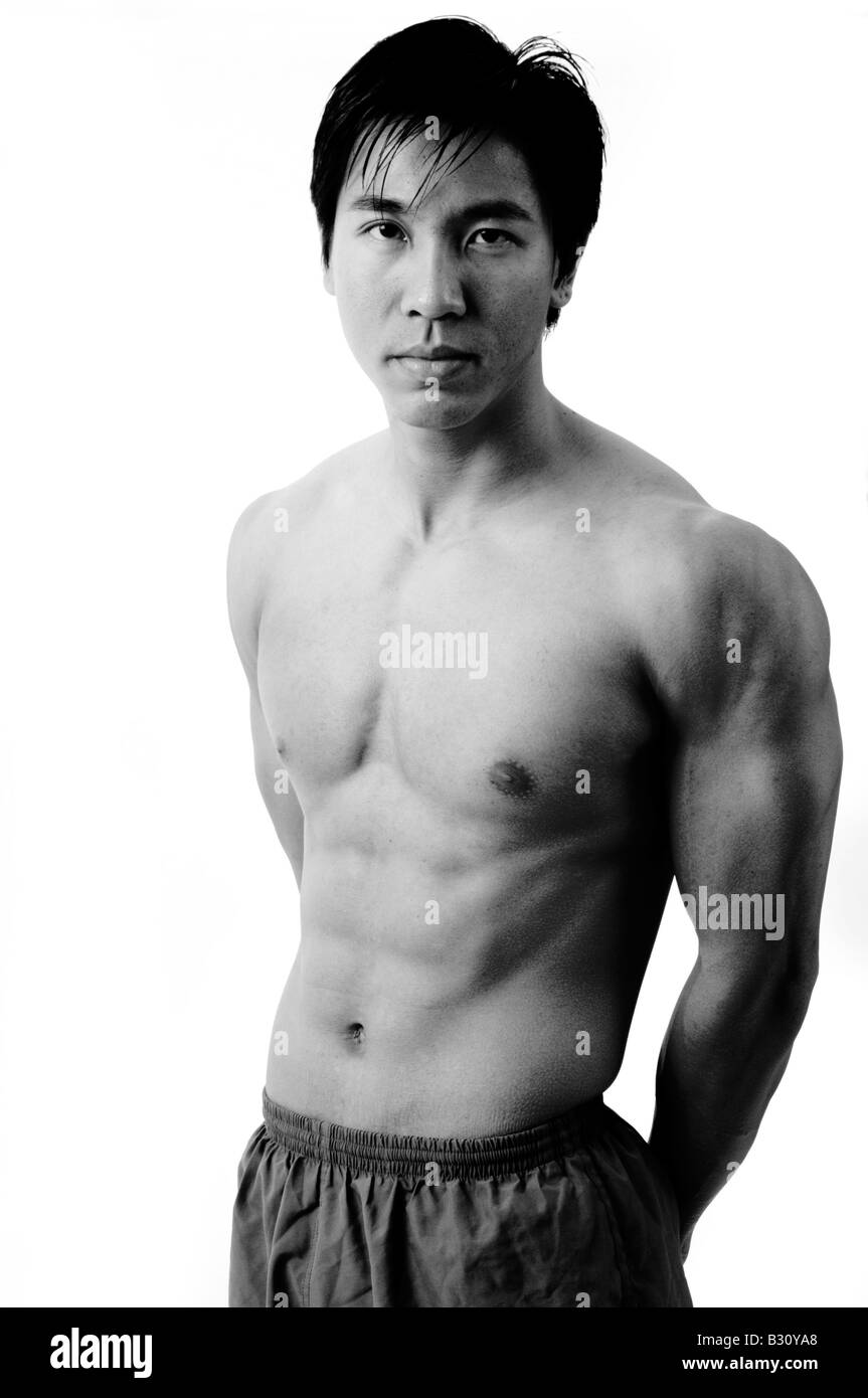 A monochrome picture of muscular chinese model - Stock Image