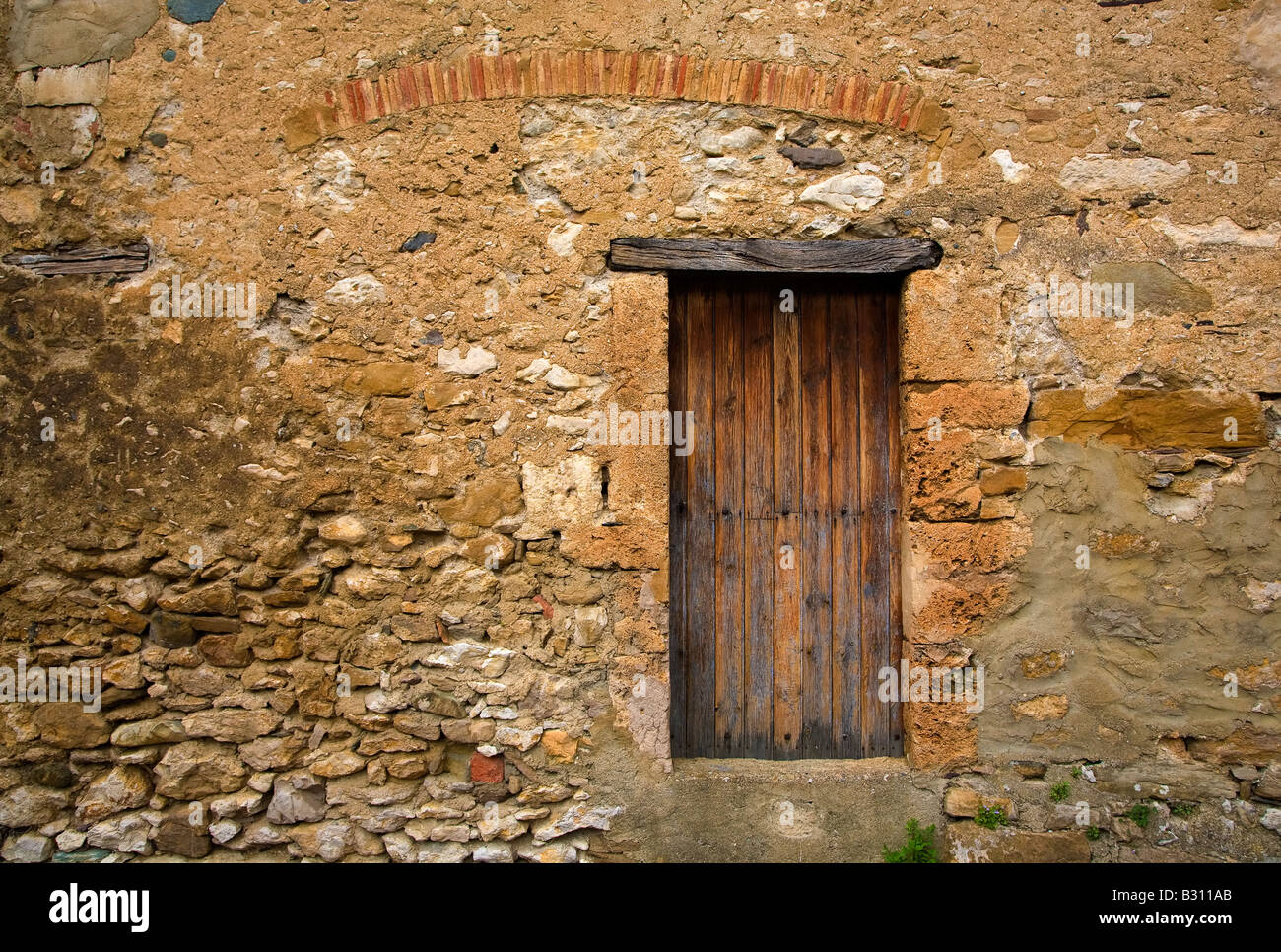Old Doorway in Minerve, Languedoc-Roussillon, France - Stock Image