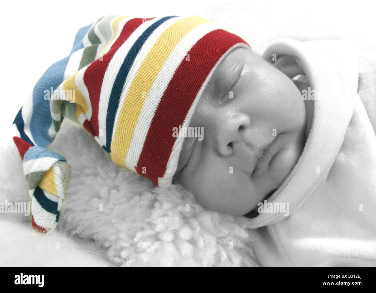 sleeping baby wearing curled jelly bag cap Stock Photo  19078182 - Alamy d47d35f3c37