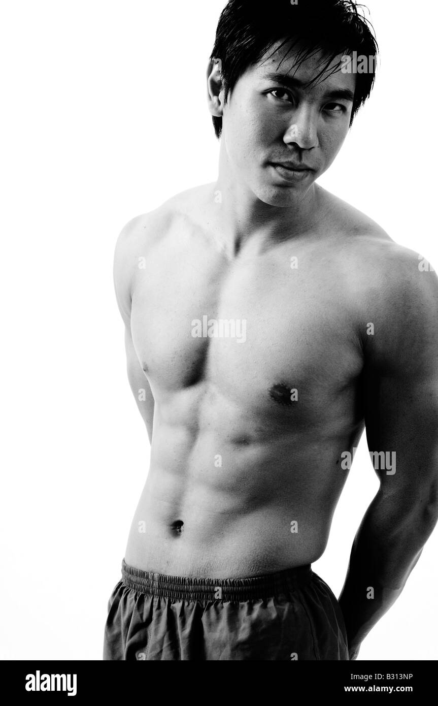 The toned body of a young chinese man - Stock Image
