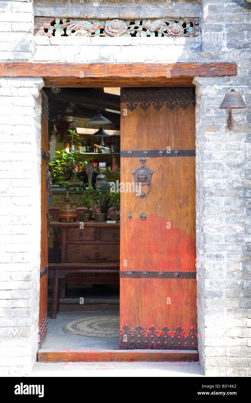 Entrance to a traditional Chinese hutong house on Nan Luogu Xiang - Stock Image
