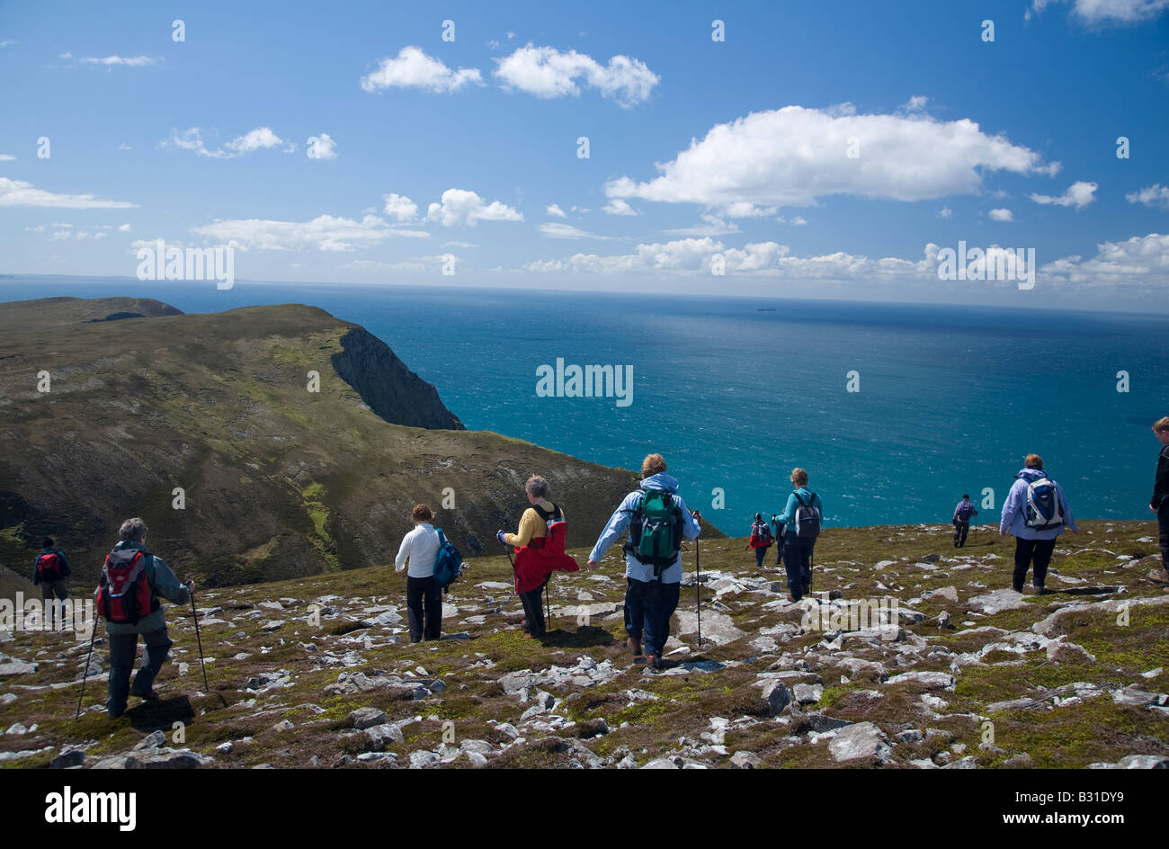 Hikers exploring the Menawn Cliffs, Achill Island, County Mayo, Ireland. - Stock Image