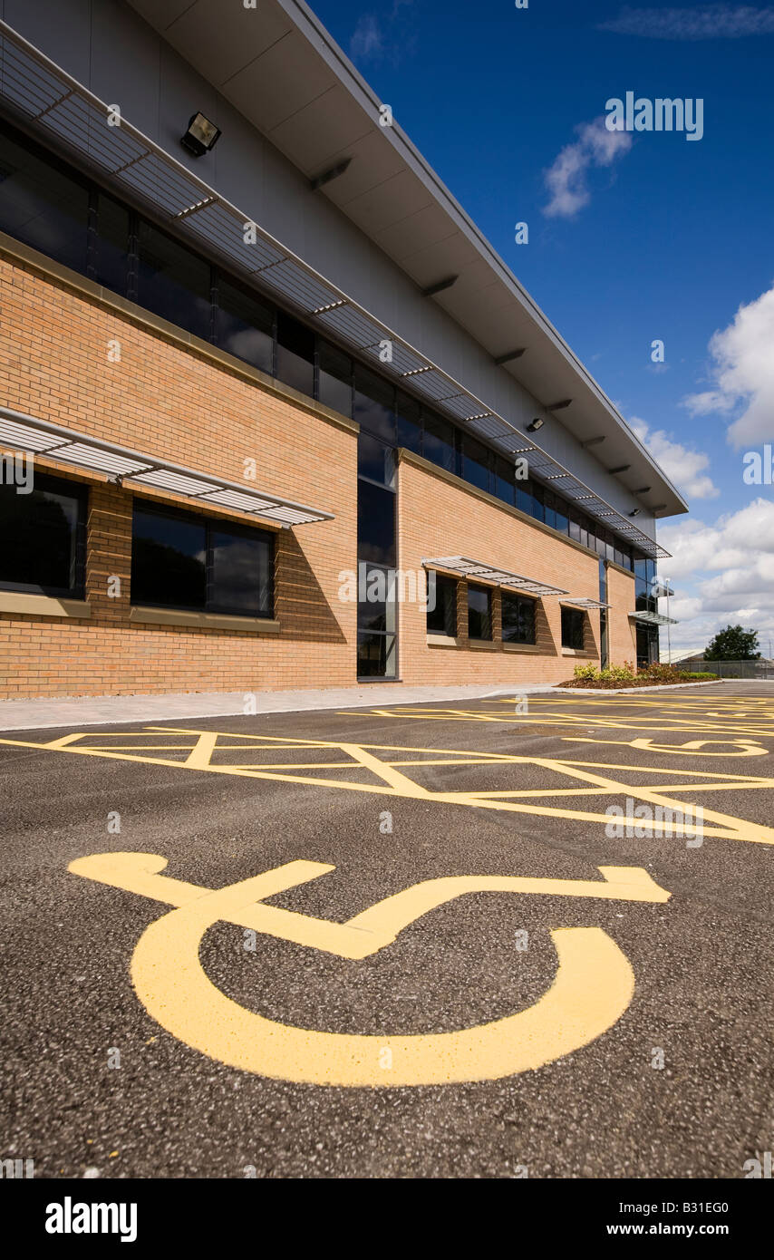 UK disability disabled parking place outside newly built office building - Stock Image