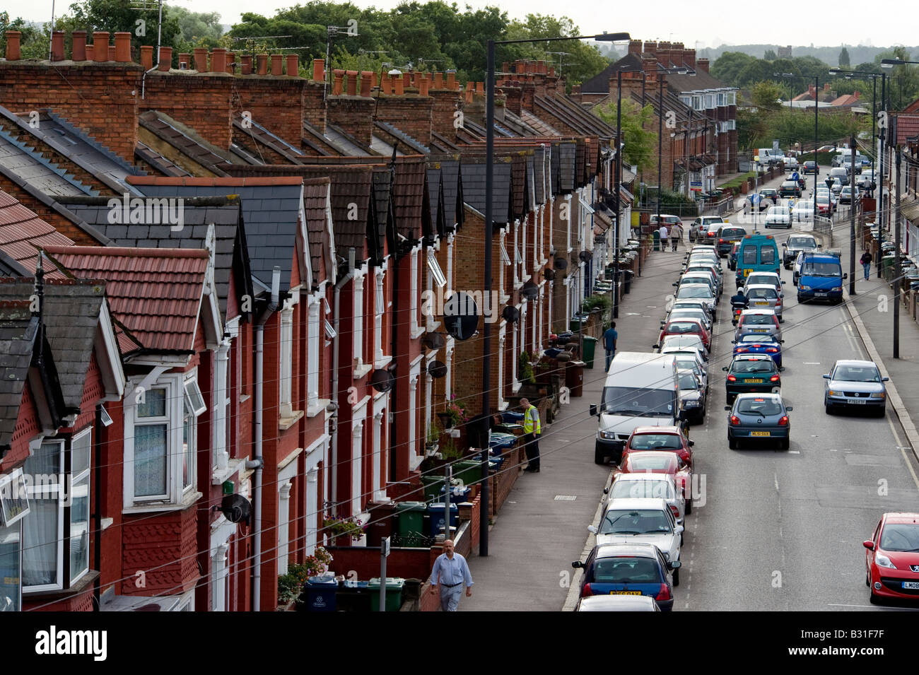 A row of terraced houses in a typical street in the London suburb of Harrow - Stock Image