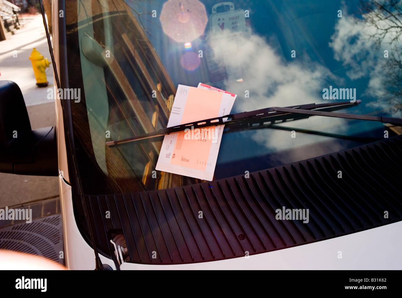 A parking ticket on a Mini-van windscreen - Stock Image