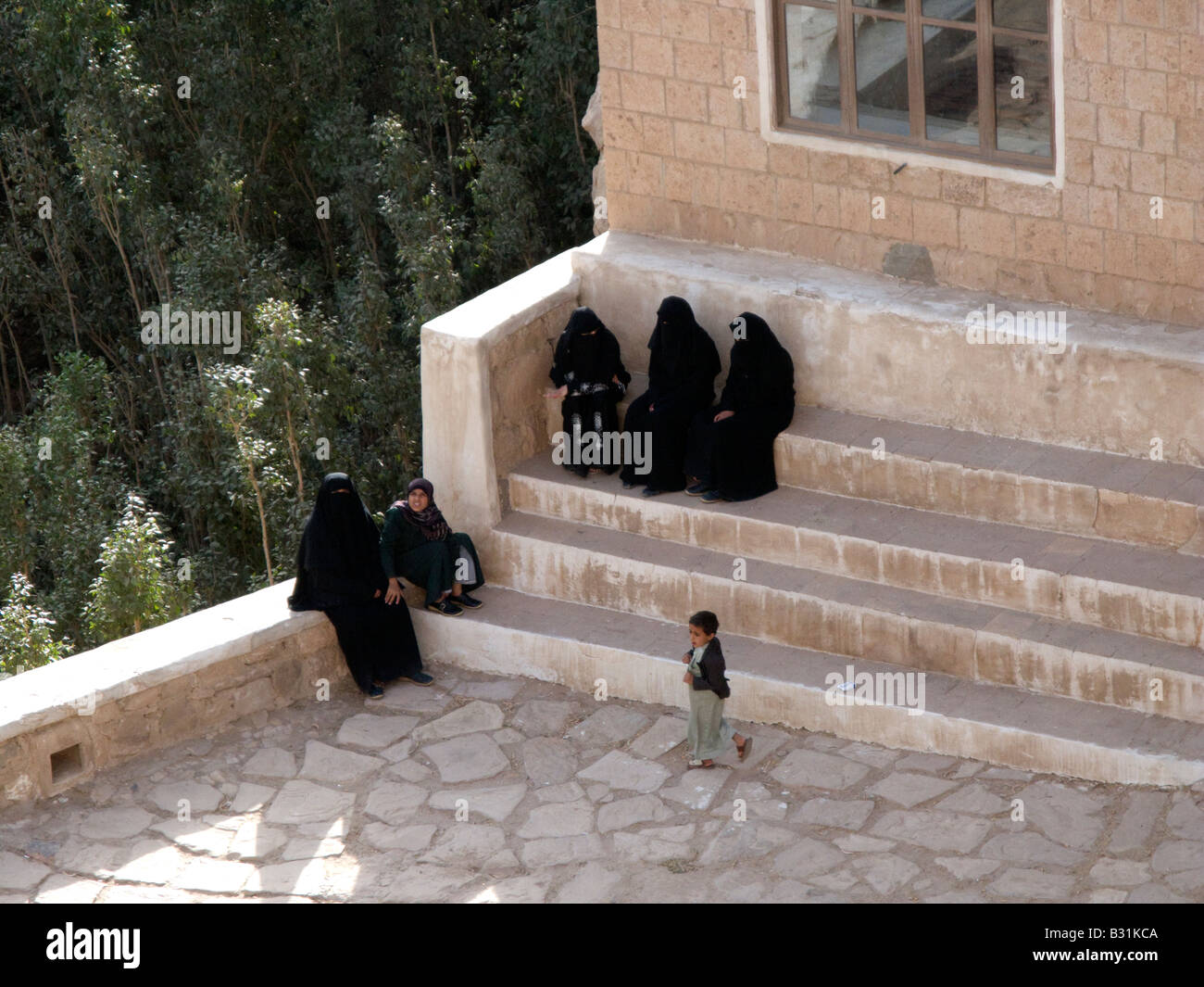 Muslim women sit together wearing the Niqab traditional attire of Muslim women Yemen Middle East - Stock Image